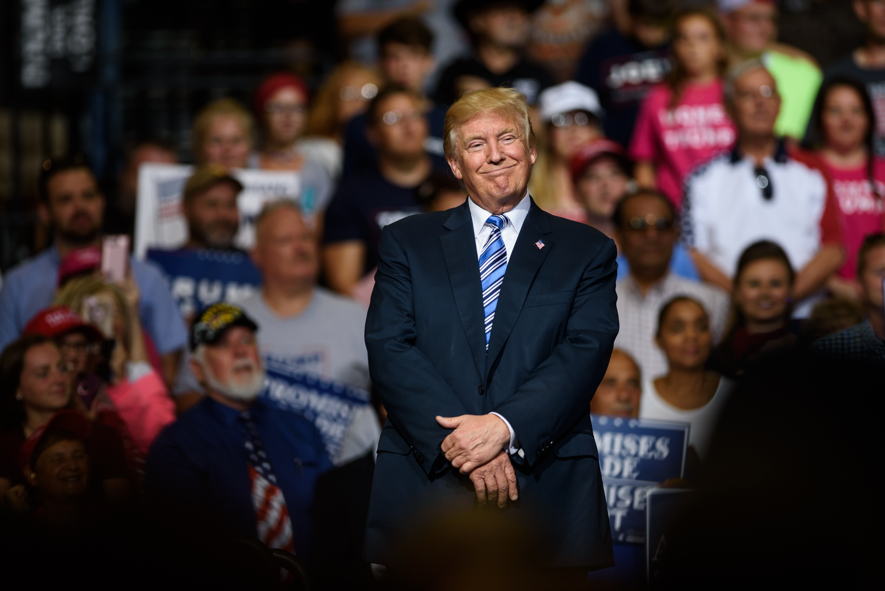 President Donald J. Trump listens as West Virginia Governor Jim Justice announces that he is switching parties to become a republican during the president's campaign rally at the Big Sandy Superstore Arena on August 3, 2017 in Huntington, West Virginia.