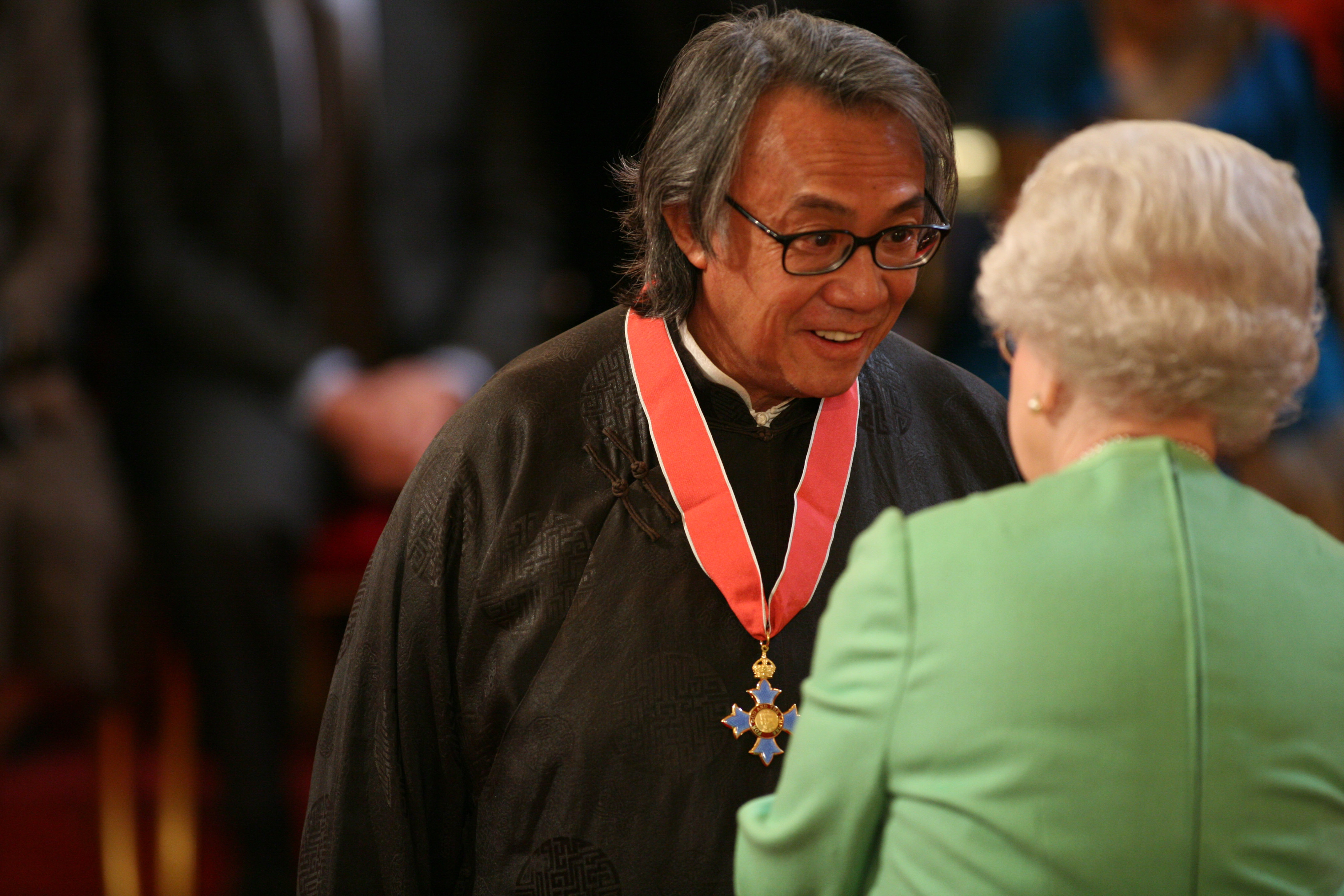 Sir David Tang is knighted by the Queen at Buckingham Palace in February 2008.