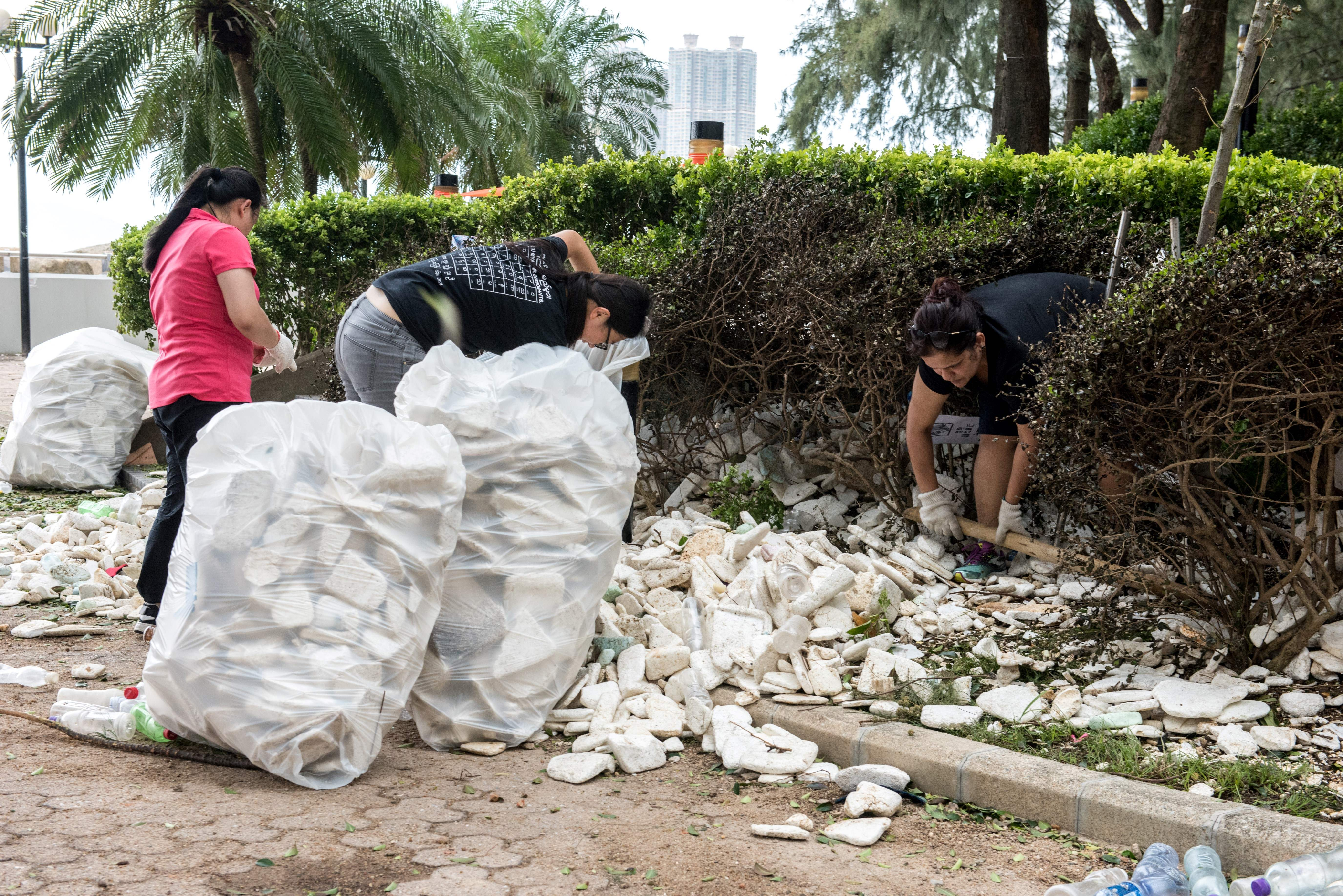 Residents and government workers pick up polystyrene and other rubbish in Heng Fa Chuen, Hong Kong, Aug. 24, 2017.