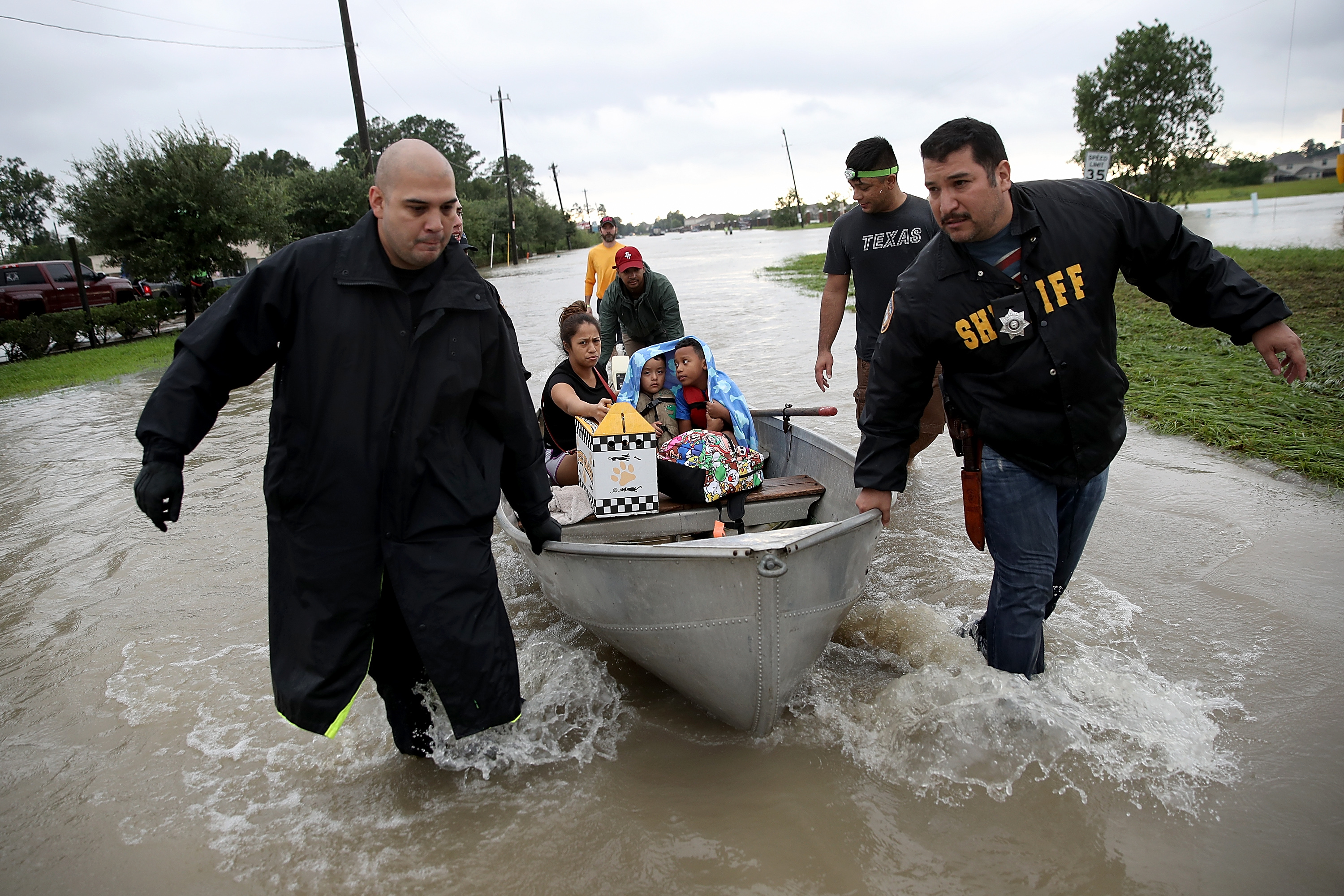 The Tellez family is evacuated from their home after severe flooding following Hurricane Harvey in north Houston August 29, 2017 in Houston, Texas.