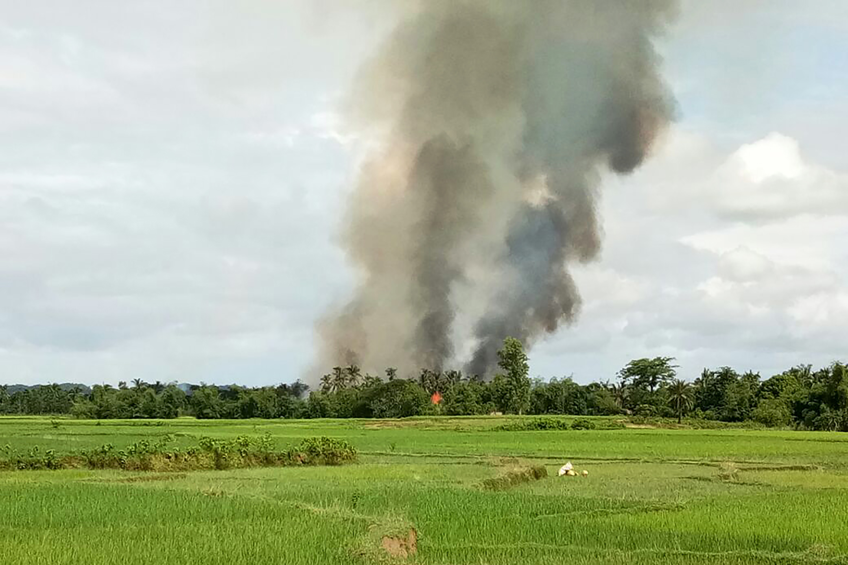 Smoke rises from what is believed to be a burning village near Maungdaw in Myanmar's Rakhine state on Aug. 30, 2017.