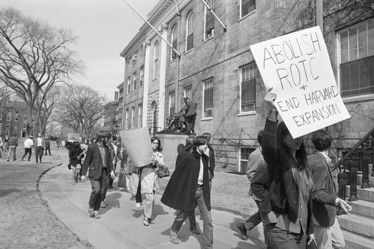 Students demonstrating at Harvard University  march past the statue of John Harvard en route to taking over University Hall in April of 1969