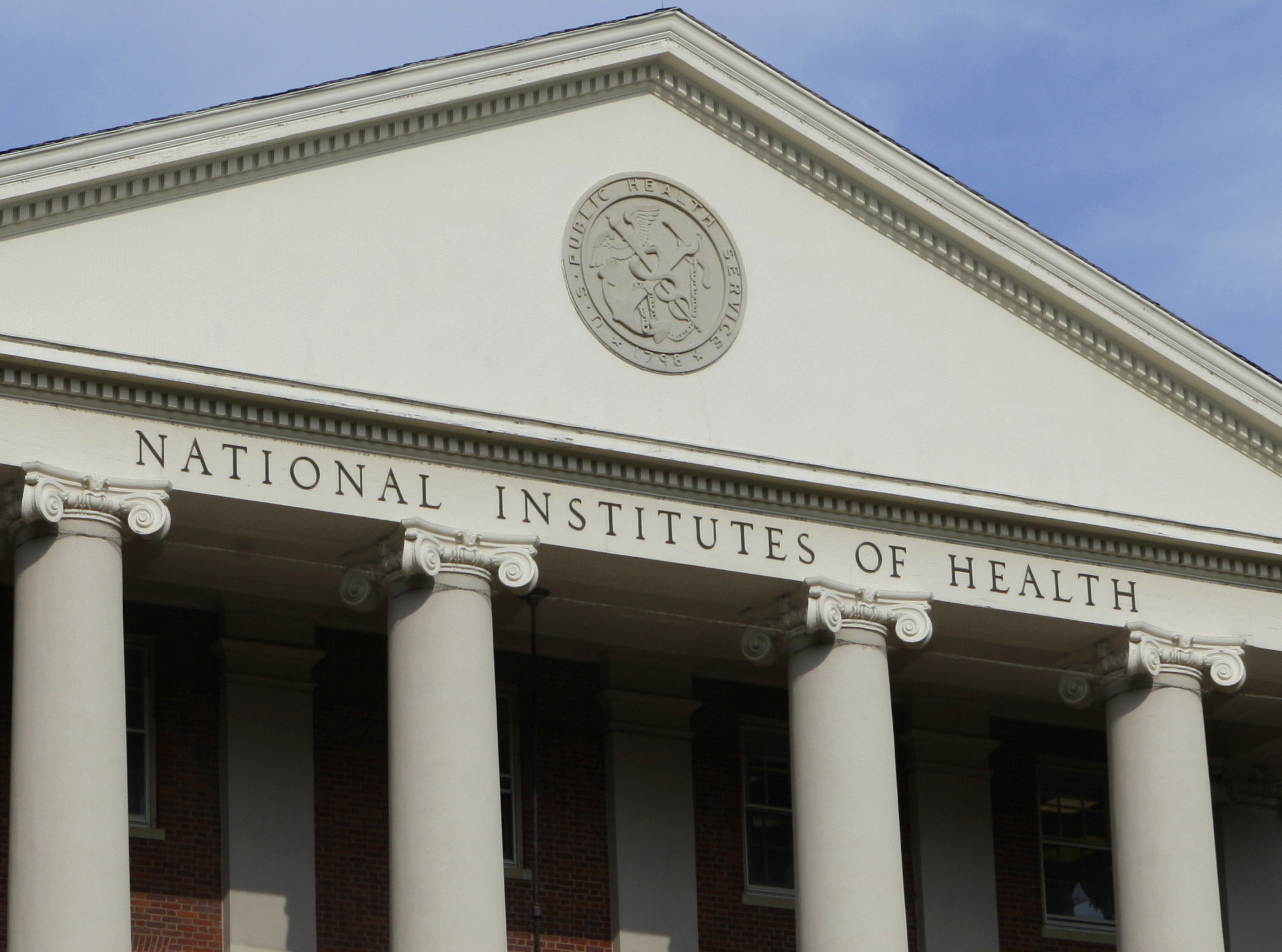 The administrative building of the National Institutes of Health is shown in Bethesda, Md., Monday, Aug. 17, 2009.