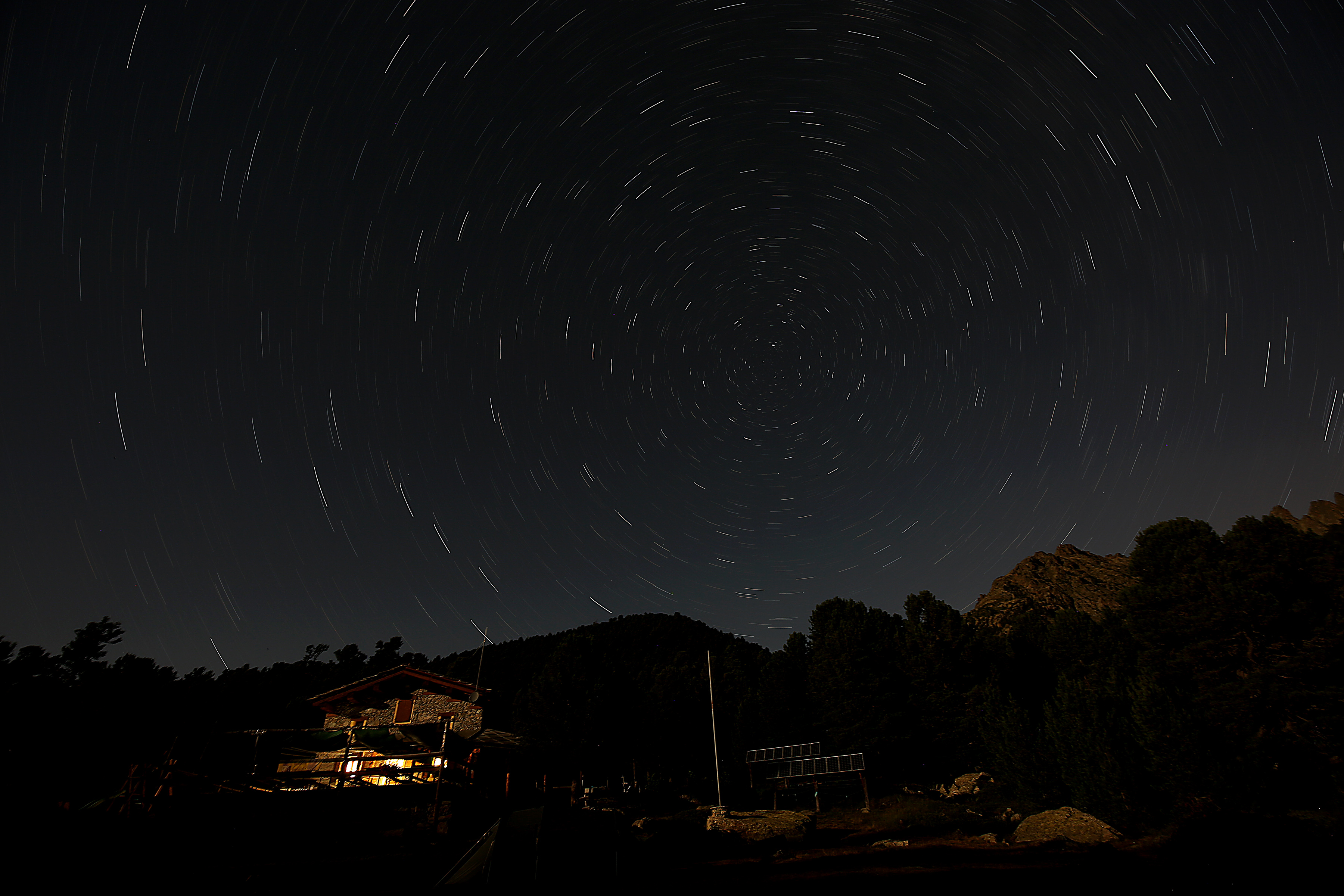 The Bagnour alpine refuge is seen at night during the annual Perseid meteor shower in the Aleve wood in Pontechianale, near Cuneo, in the Monte viso Alps, northern Italy, on Aug. 13, 2016.