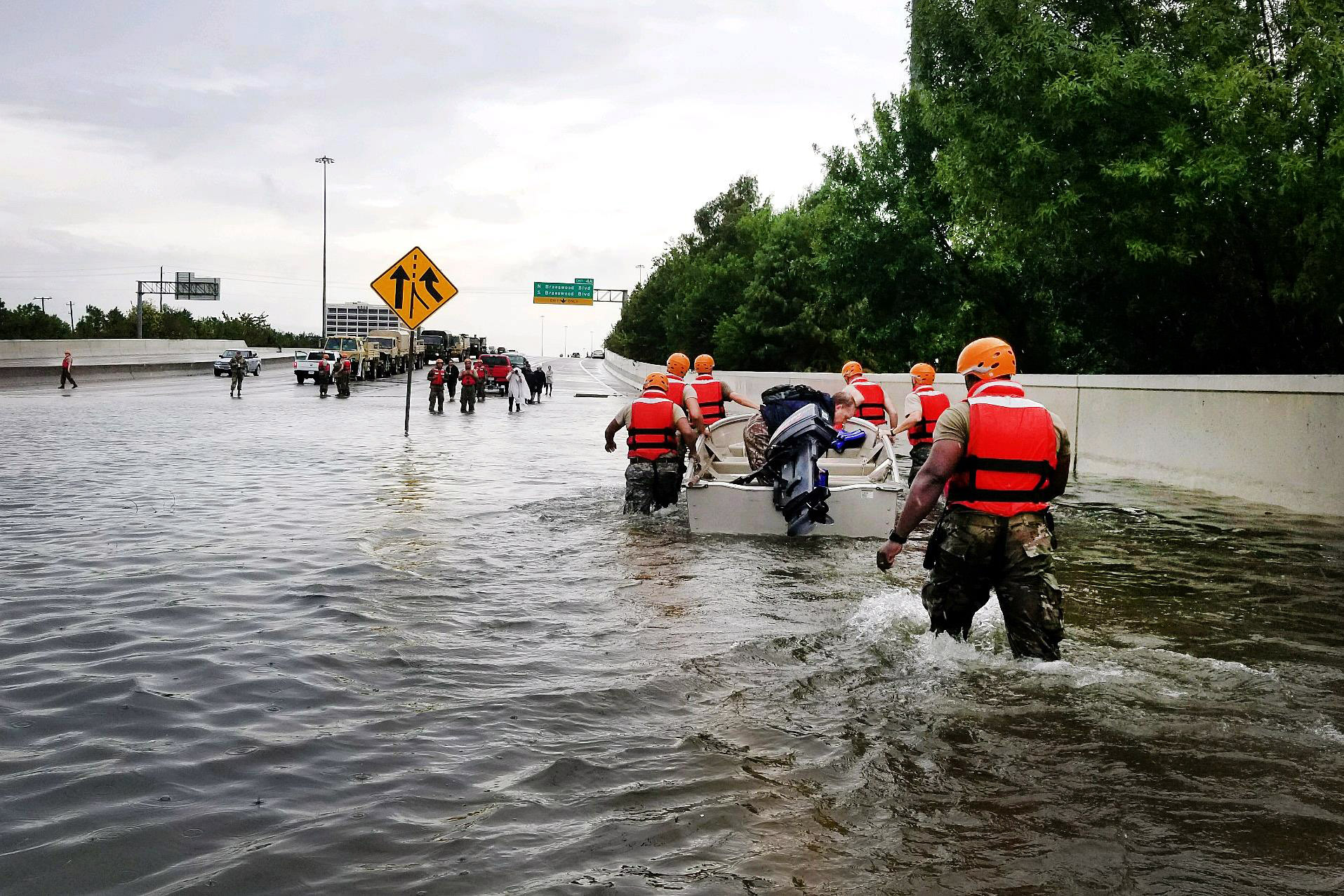 Texas National Guardsmen rescue a resident by boat during flooding caused by Hurricane Harvey August 27, 2017 in Houston, Texas.