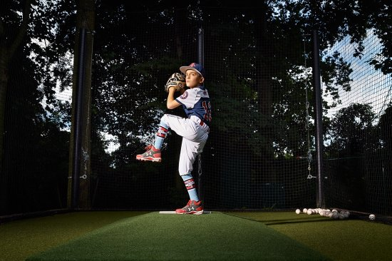 """""""I love working hard,"""" says Joey Erace, 10, who lives in southern New Jersey but has suited up for baseball teams based in California and Texas. His Instagram account @joeybaseball12 has more than 24,000 followers. Here Joey is photographed at home in Mullica Hill, New Jersey where his father set up a batting cage in their yard where he practices with a hitting coach, on Aug. 8, 2017."""