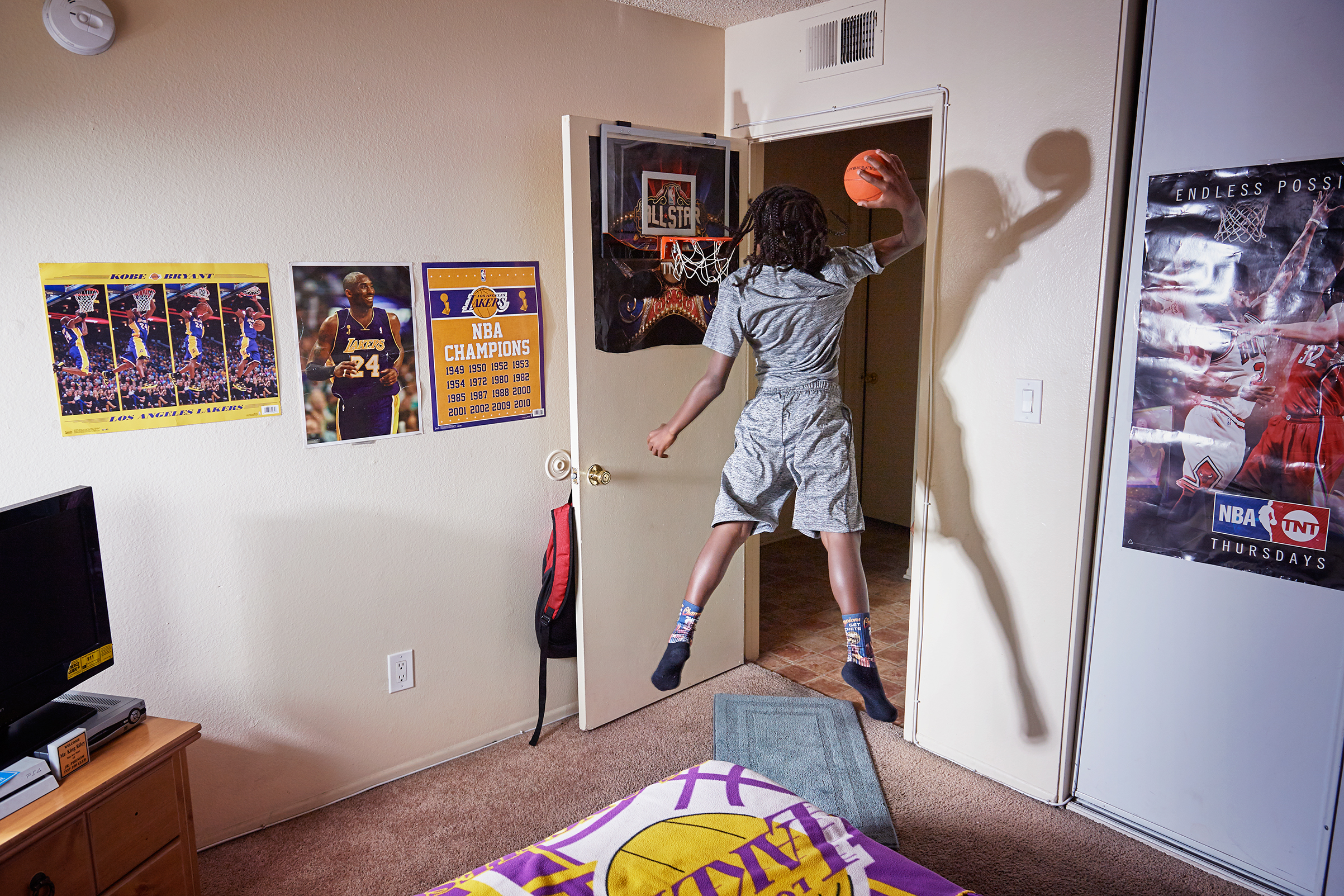 King-Riley Owens, 9, who is ranked as a five-star prospect by the National Youth Basketball Report, lives in L.A. but has already played in tournaments in Utah, Texas and Nevada. His parents have used GoFundMe to help pay for the travel. If the NBA doesn't work out, King-Riley wants to be a veterinarian. Here King-Rily is photographed at home on Aug. 2, 2017.