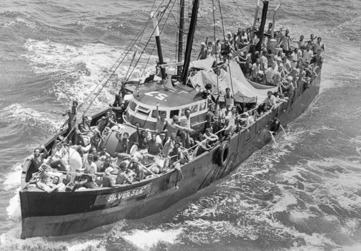 A fishing boat loaded with Cuban refugees heads towards Key West in June of 1980.