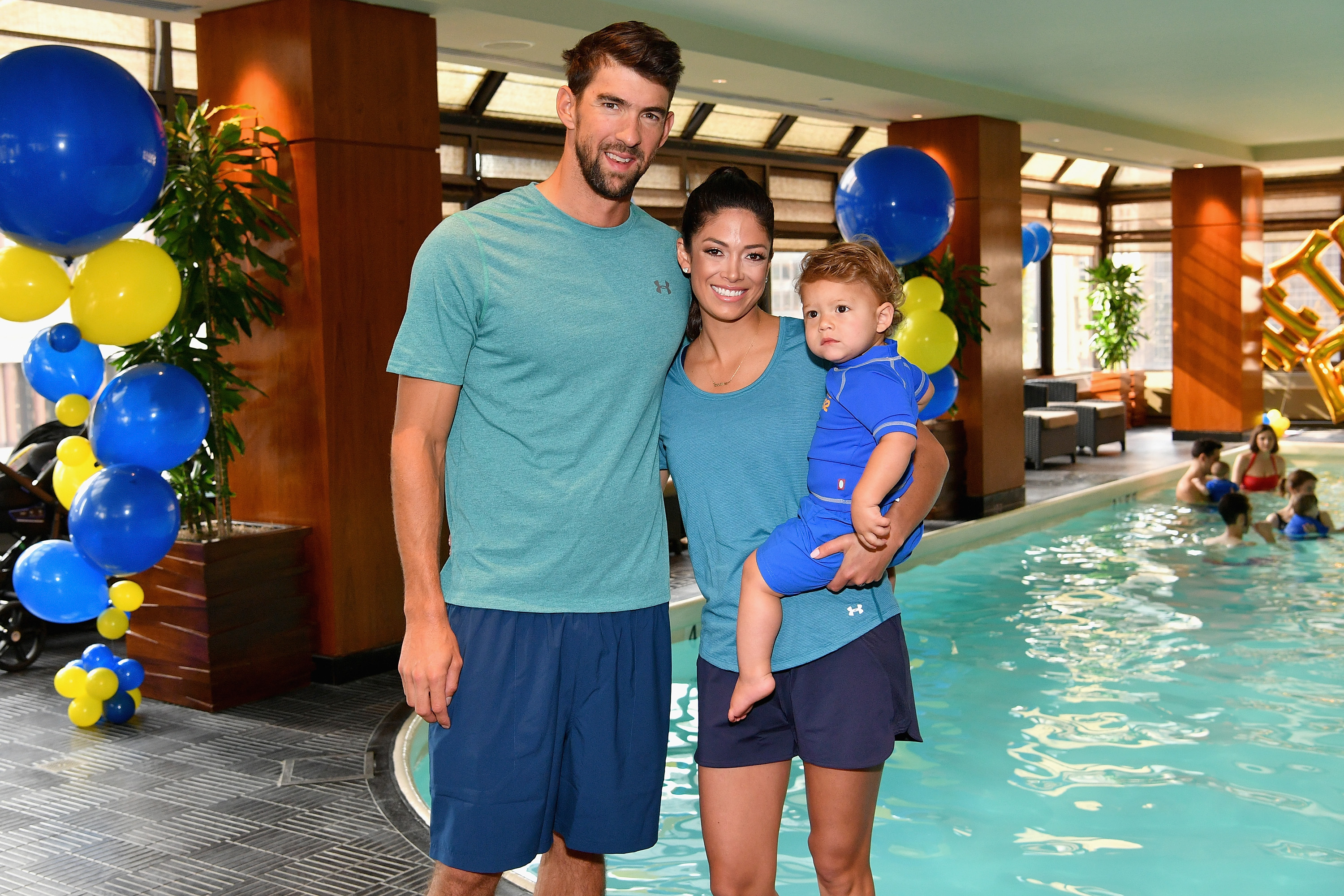 Michael Phelps, Nicole Phelps and Boomer Phelps attend the Huggies Little Swimmers #trainingfor2032 Swim Class With The Phelps Foundation on August 21, 2017 in New York City.