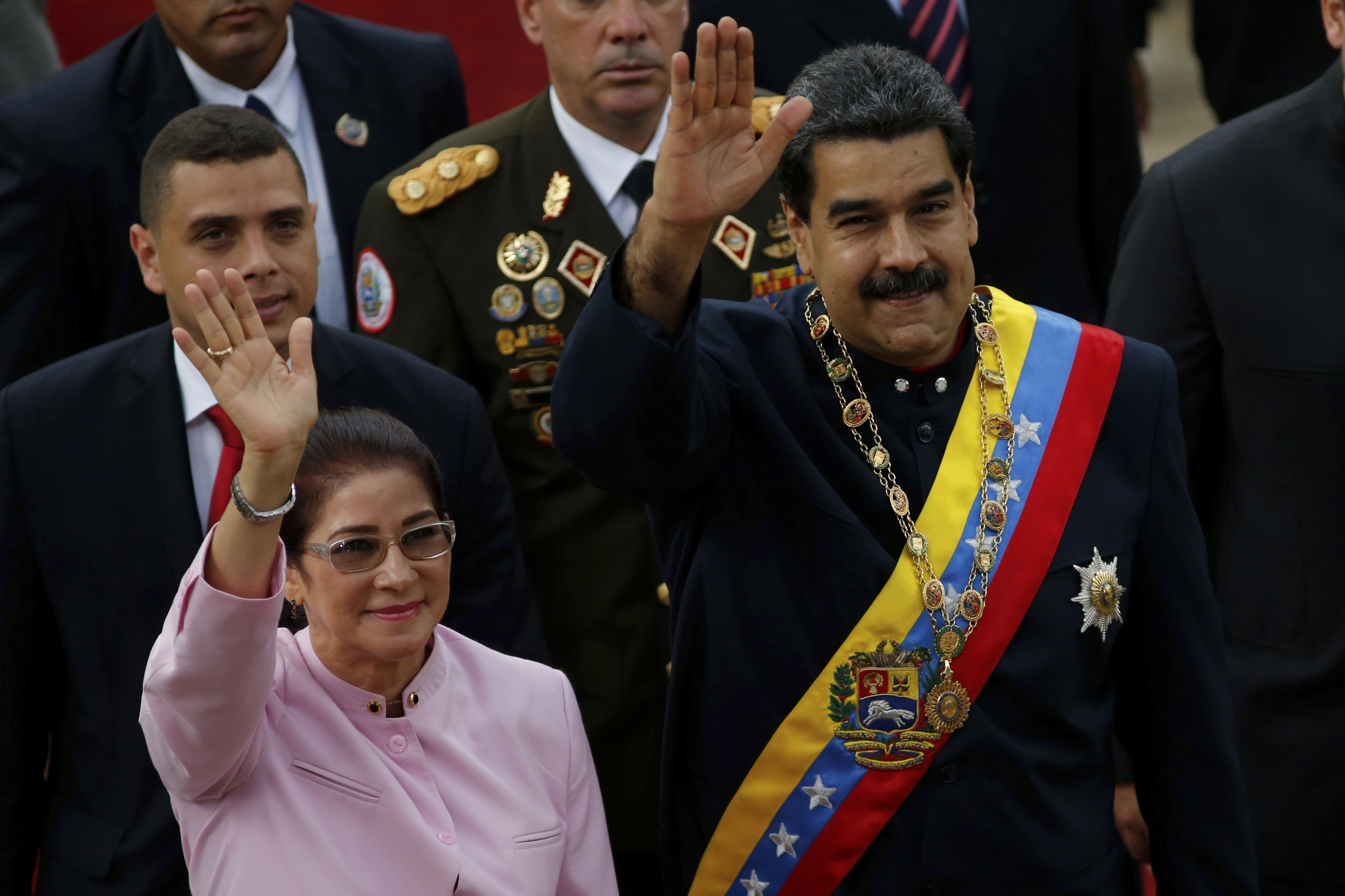 Venezuela's President Nicolas Maduro, right, and his wife Cilia Flores wave as they arrive to the National Assembly building for a session of the Constitutional Assembly in Caracas, Venezuela, Aug. 10, 2017.