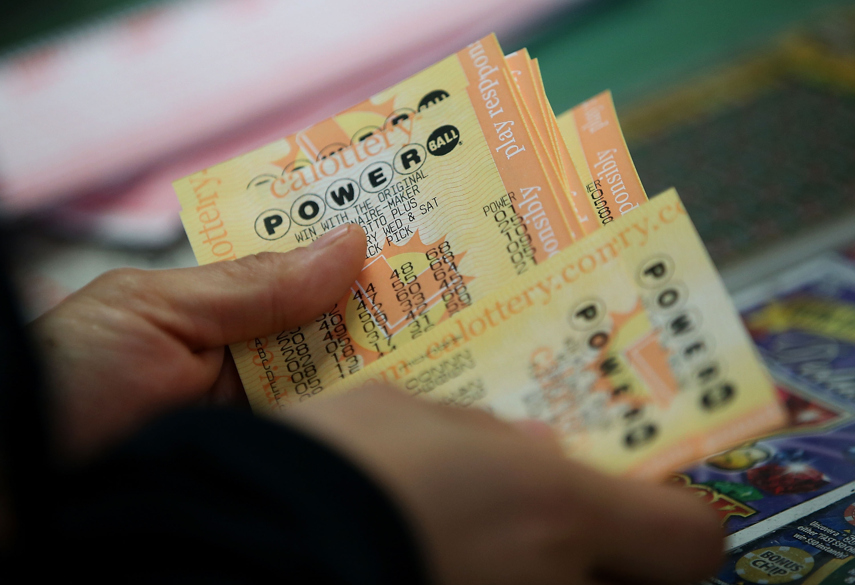 A customer buys Powerball tickets at Kavanagh Liquors on January 13, 2016 in San Lorenzo, California.