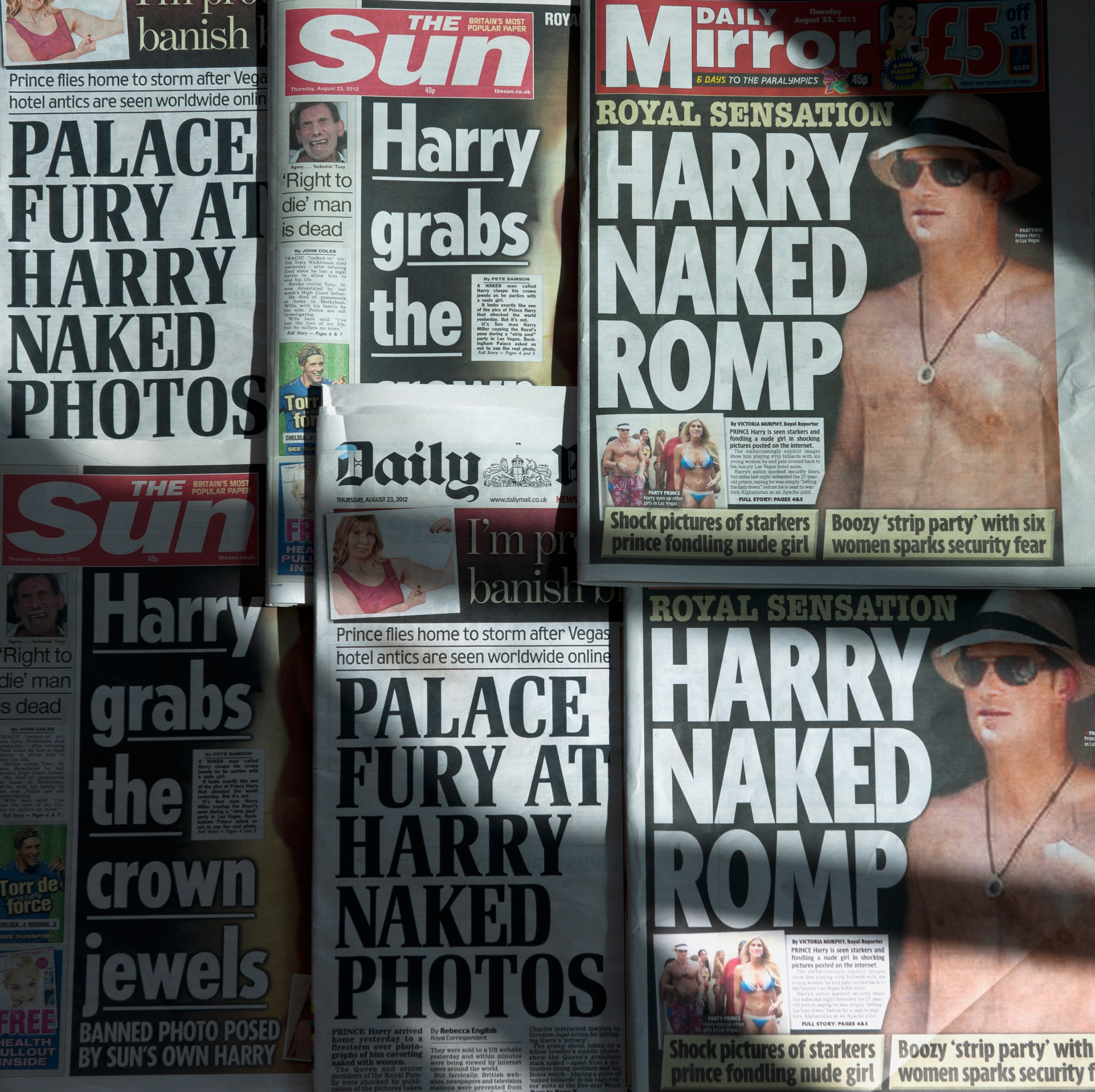 An arrangment of British daily newspapers photographed in London on August 23, 2012 shows the front-page headlines and stories regarding nude pictures of Britain's Prince Harry. Daniel Sorabj—AFP/Getty Images.