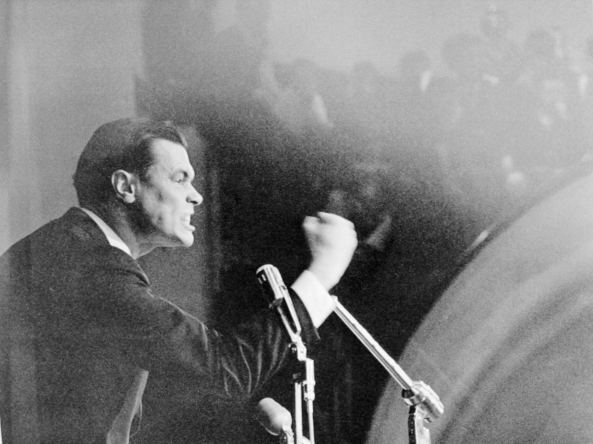 George Lincoln Rockwell, leader of the American Nazi Party, shakes his fist during his speech at Drake University in early 1967.