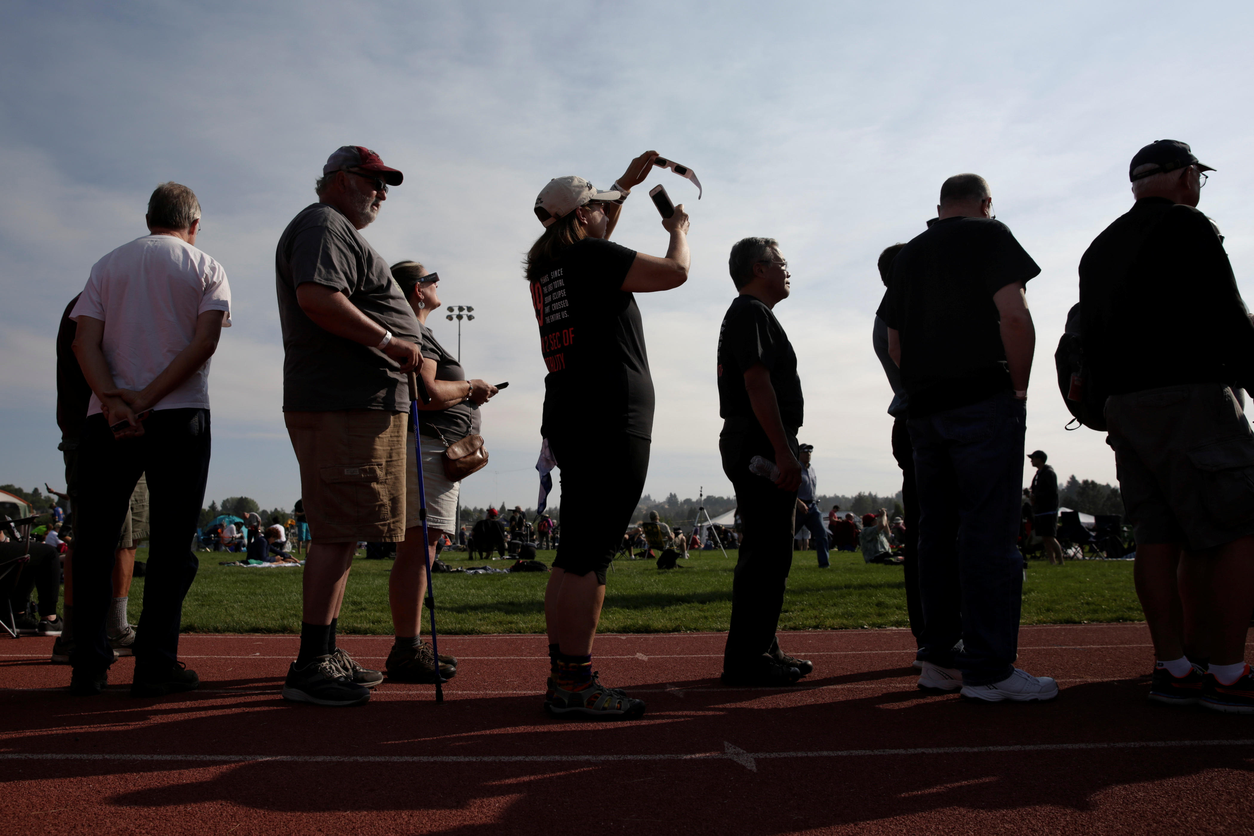 People watch the solar eclipse during the Lowell Observatory Solar Eclipse Experience at Madras High School in Madras, Oregon on Aug. 21, 2017.