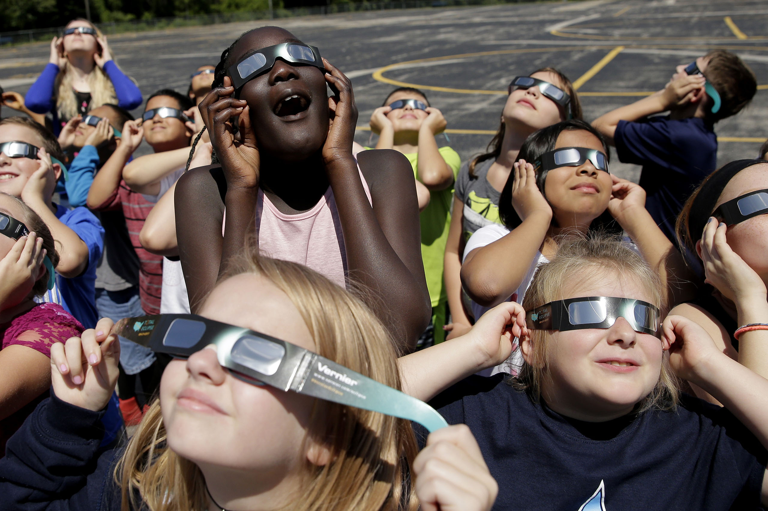 Fourth graders at Clardy Elementary School in Kansas City, Mo. practice the proper use of their eclipse glasses on Aug. 18, 2017 in anticipation of the solar eclipse.