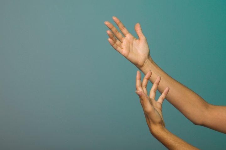 Hands reaching upward