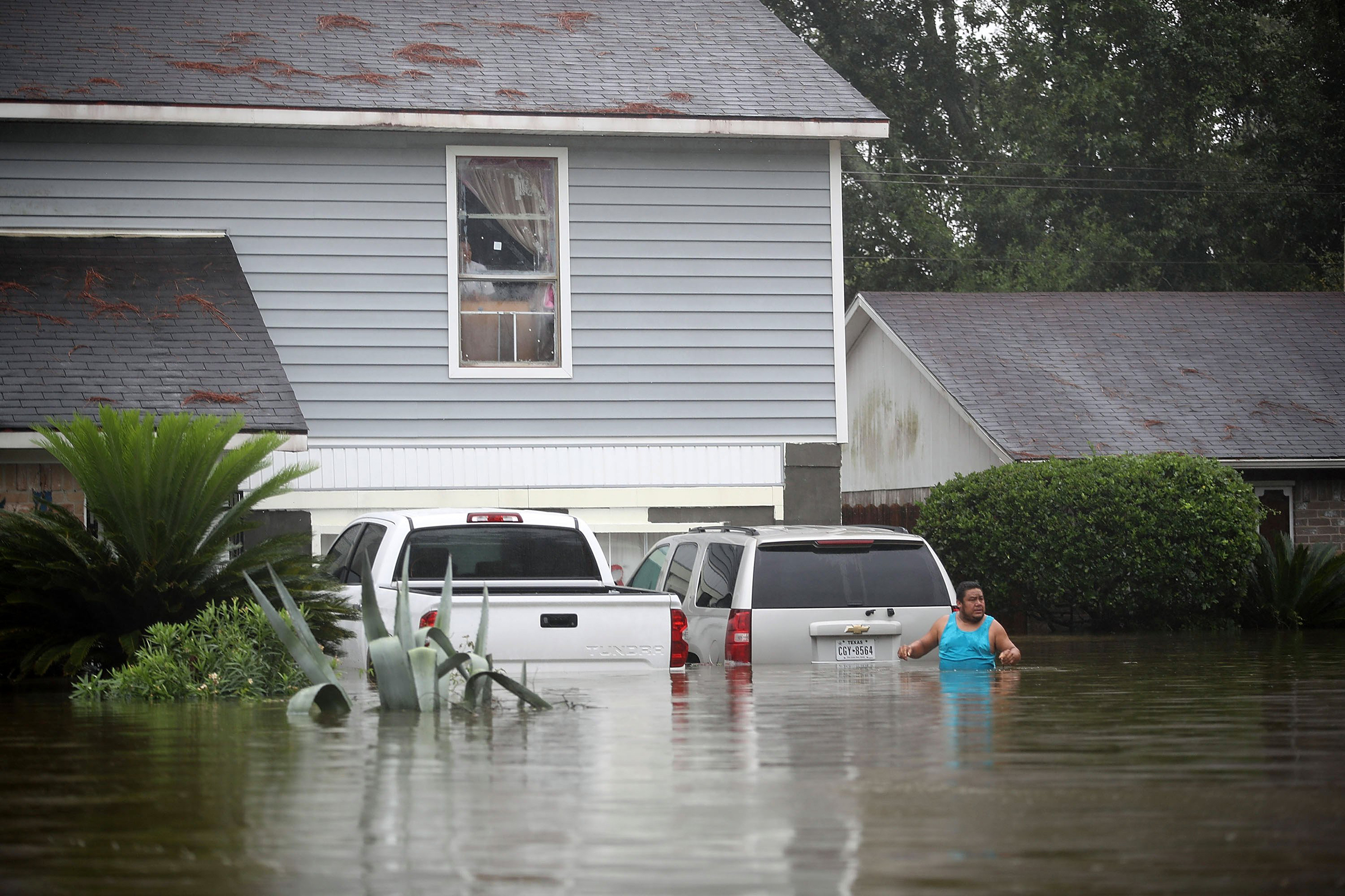 People wait to be rescued from their  flooded homes after the area was inundated with flooding from Hurricane Harvey on August 28, 2017 in Houston, Texas.