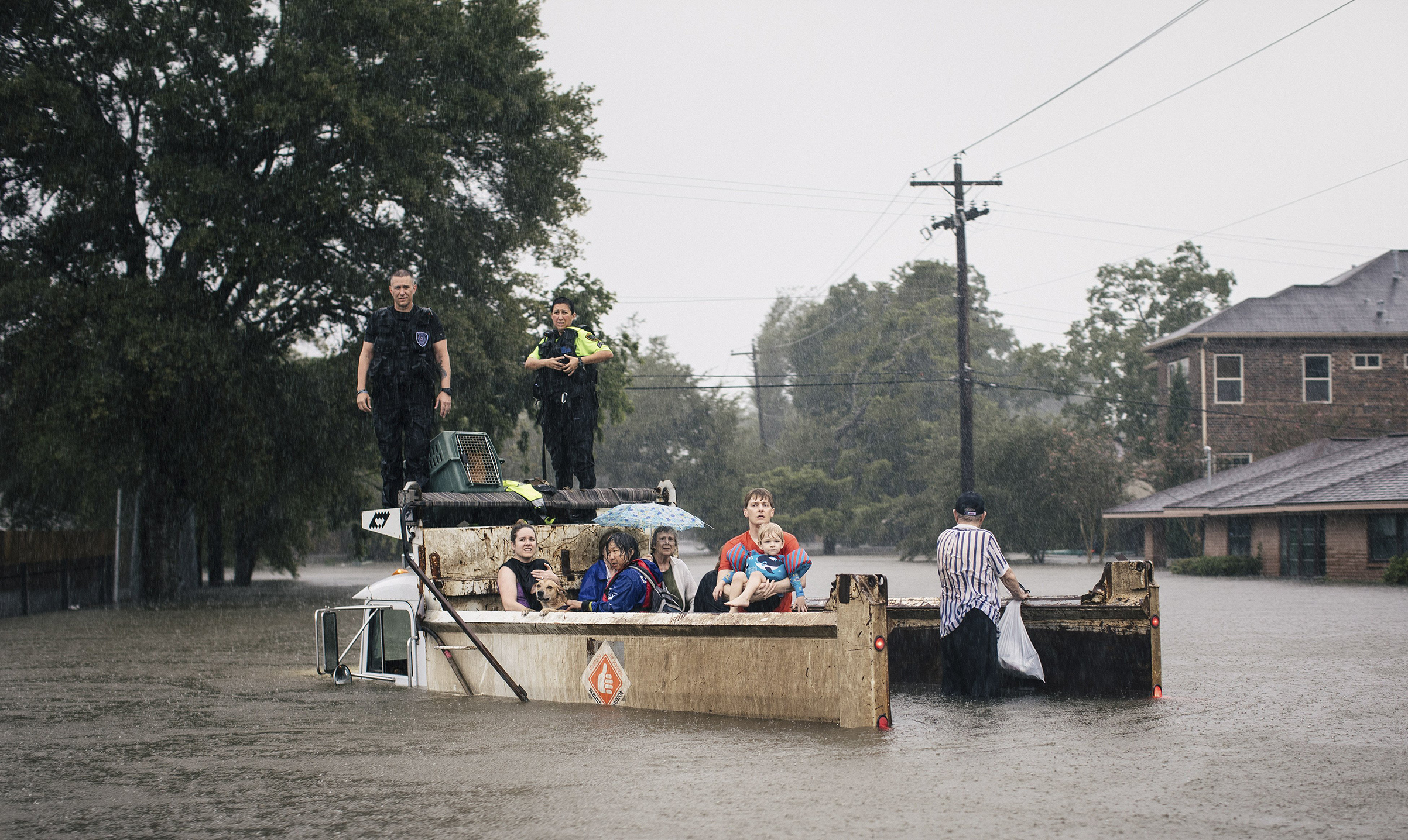 Rescue workers and civilians wait for emergency crews in Houston, Aug. 27, 2017.