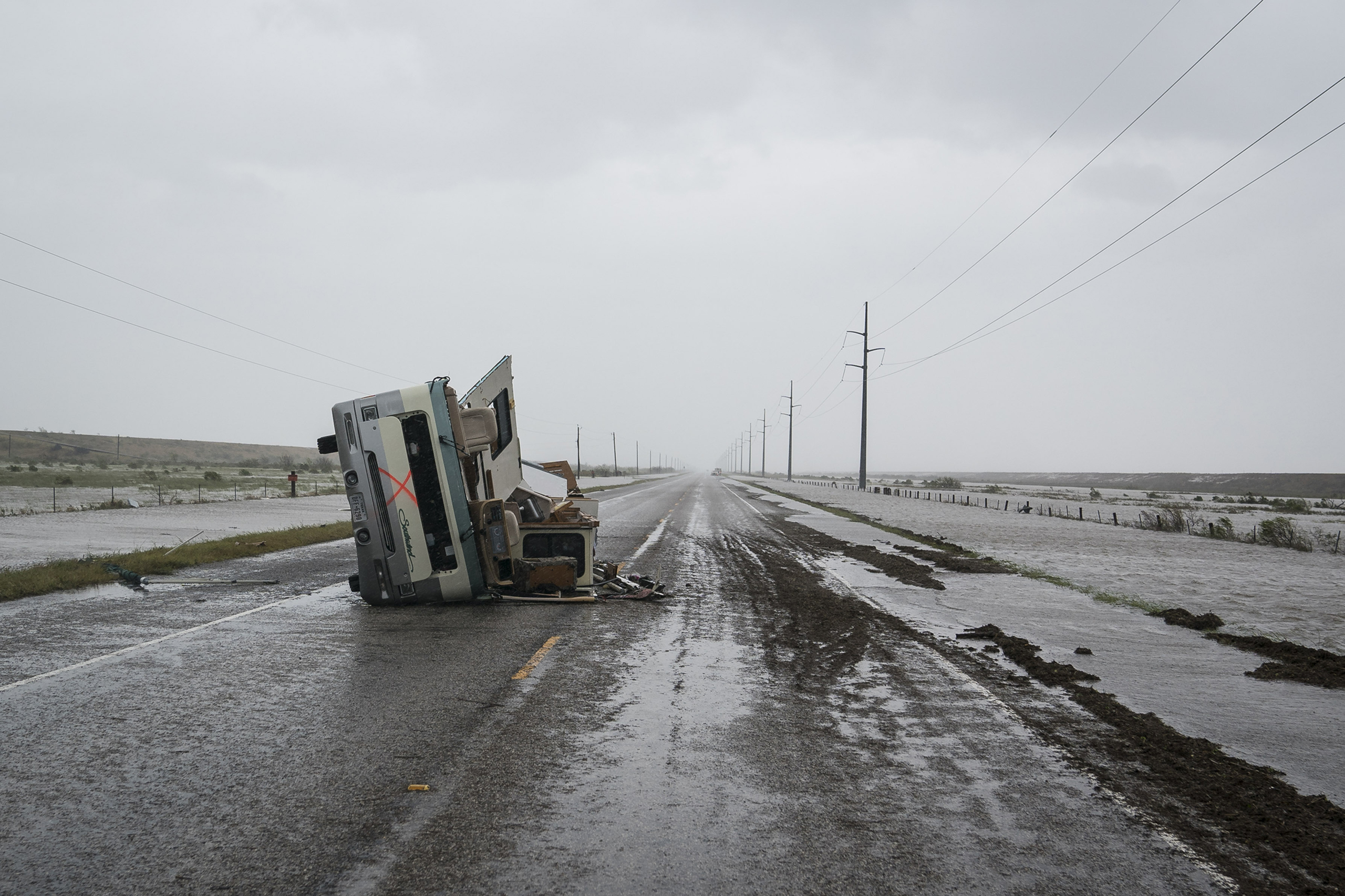 An RV is seen destroyed along the road near City-By-The Sea, TX as Hurricane Harvey hits the Texas coast on Aug 26, 2017.