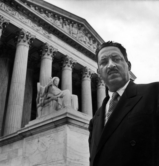 NAACP chief counsel Thurgood Marshall standing on the steps of the Supreme Court Building, 1955.