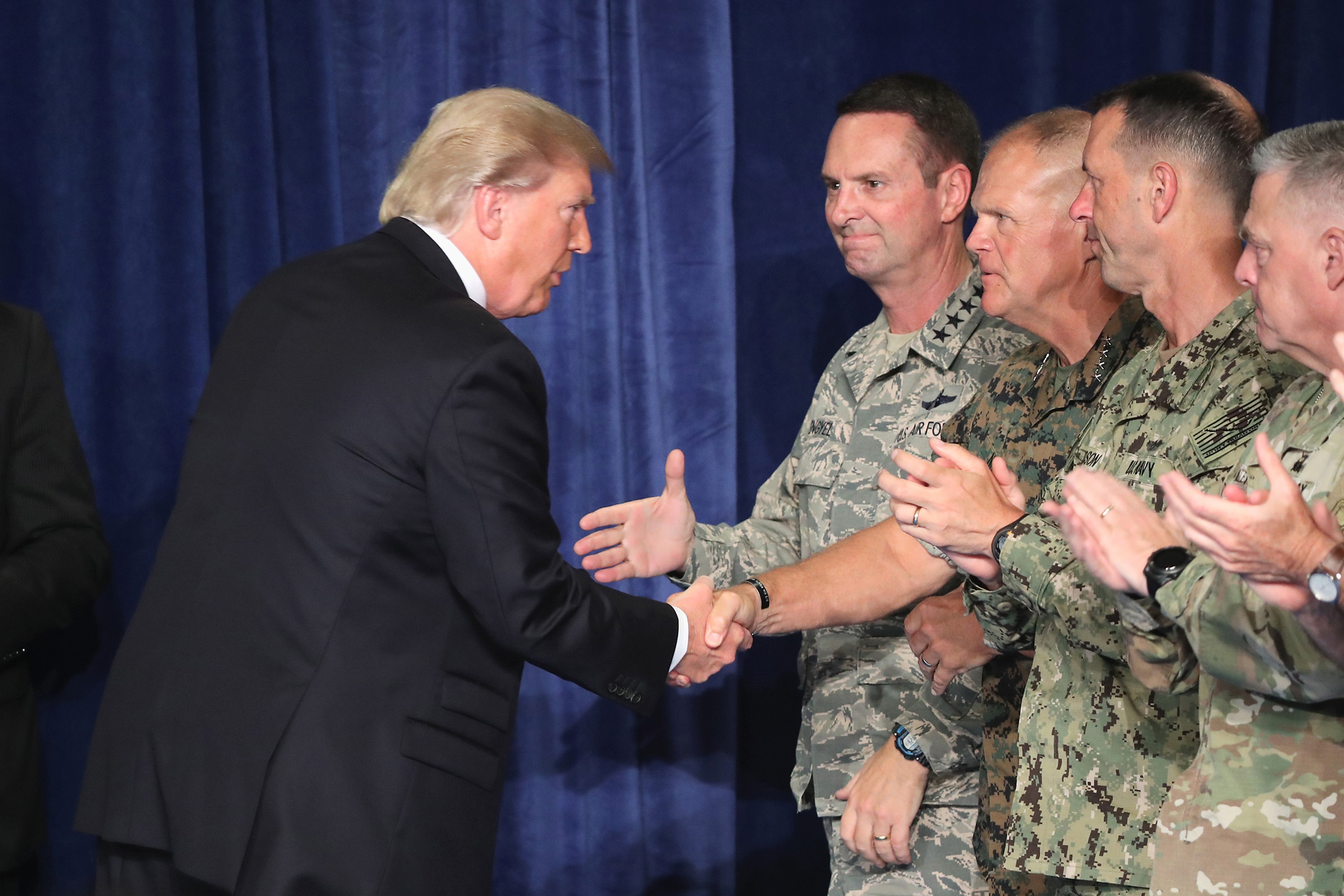 President Donald Trump greets military leaders before his speech on Afghanistan at the Fort Myer military base in Arlington, Virginia, on Aug. 21, 2017.
