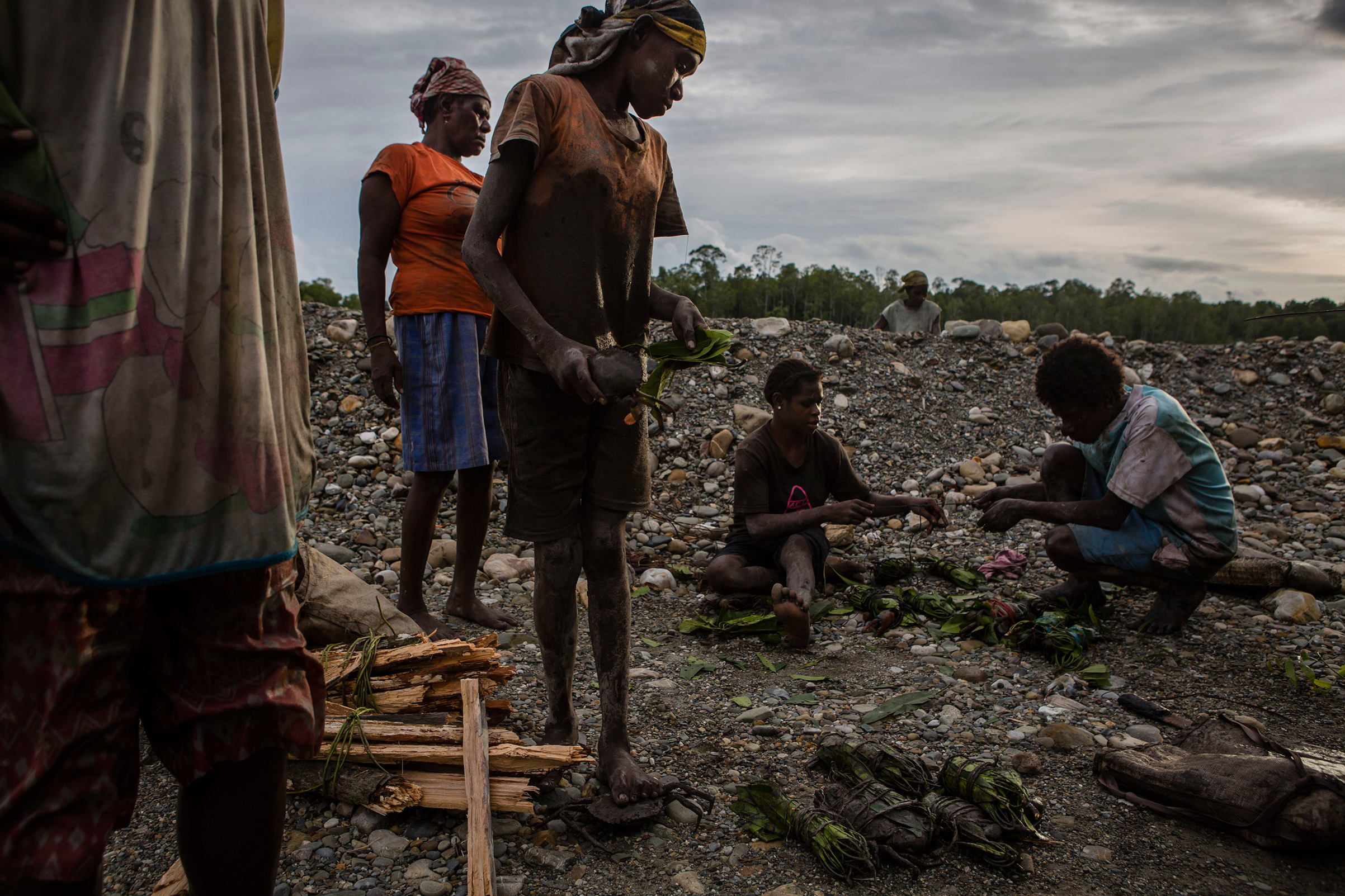 Locals work to catch crabs from the mining operations site in Timika, Papua Province, Indonesia, on Feb. 2, 2017