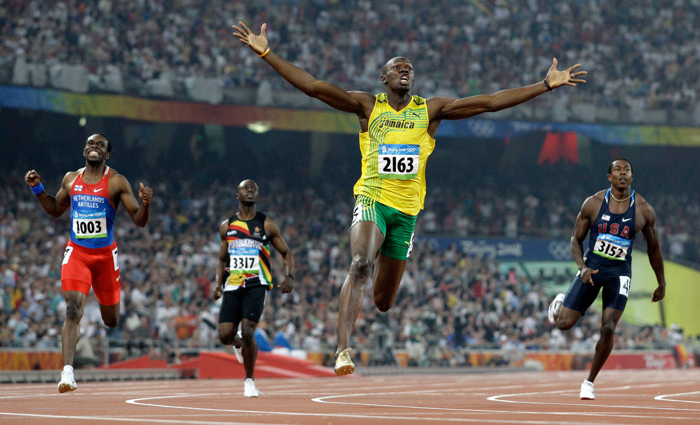 Jamaica's Usain Bolt crosses the finish line to win the gold in the men's 200-meter final during the athletics competitions in the National Stadium at the Beijing 2008 Olympics, Aug. 20, 2008.