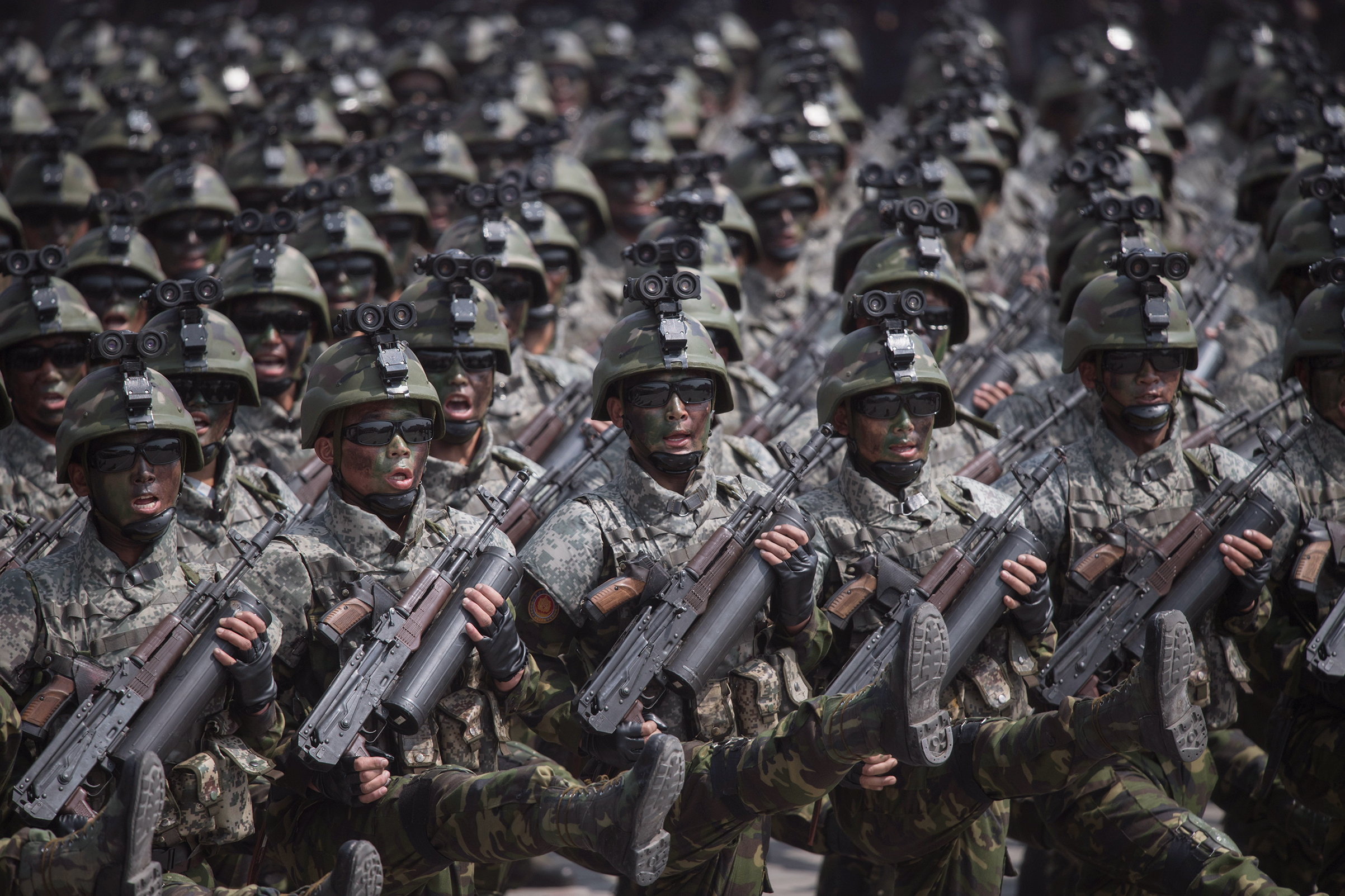 North Korean soldiers march in a military parade in Pyongyang on April 15