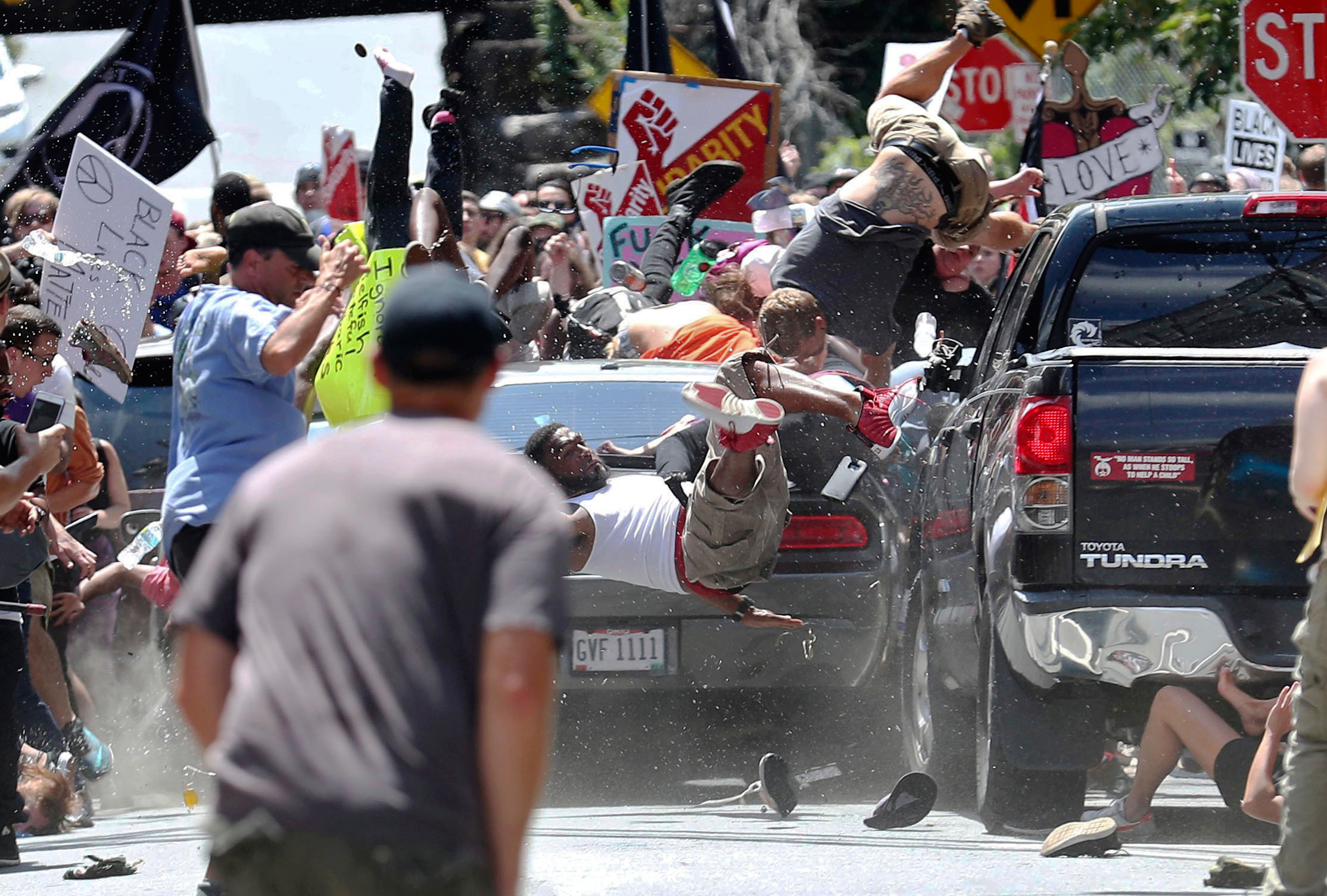 People fly into the air as a vehicle drives into a group of protesters demonstrating against a white nationalist rally in Charlottesville, Va., on Aug. 12, 2017.