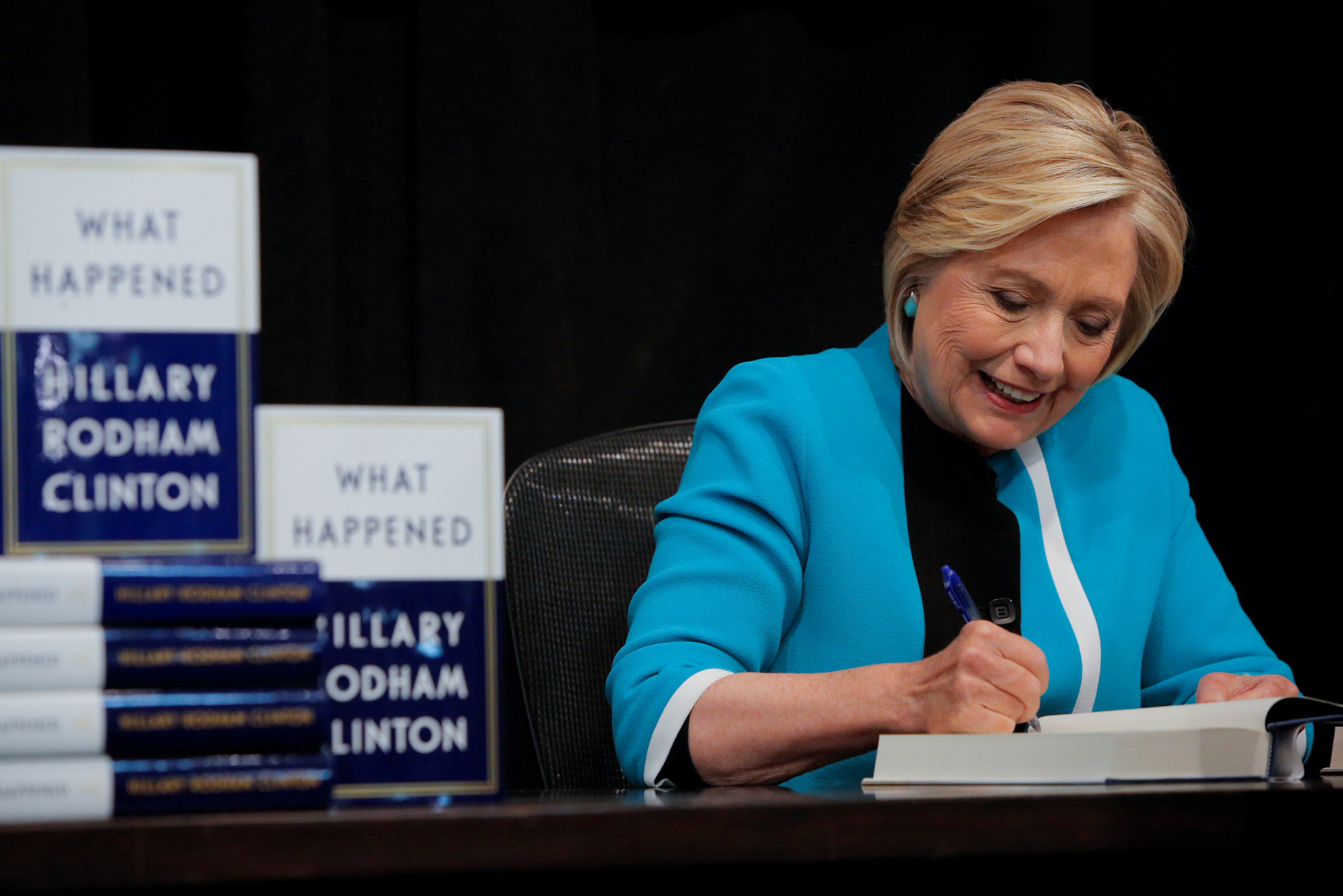 Former Secretary of State Hillary Clinton signs a copy of her new book 'What happened' at Barnes & Noble bookstore in Manhattan, New York City, U.S., September 12, 2017.