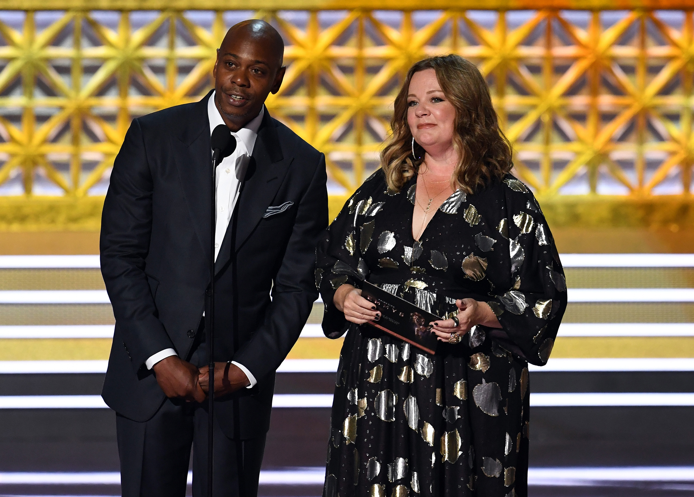 Comedian Dave Chappelle (L) and actor Melissa McCarthy speak onstage during the 69th Annual Primetime Emmy Awards at Microsoft Theater on Sept. 17, 2017 in Los Angeles.