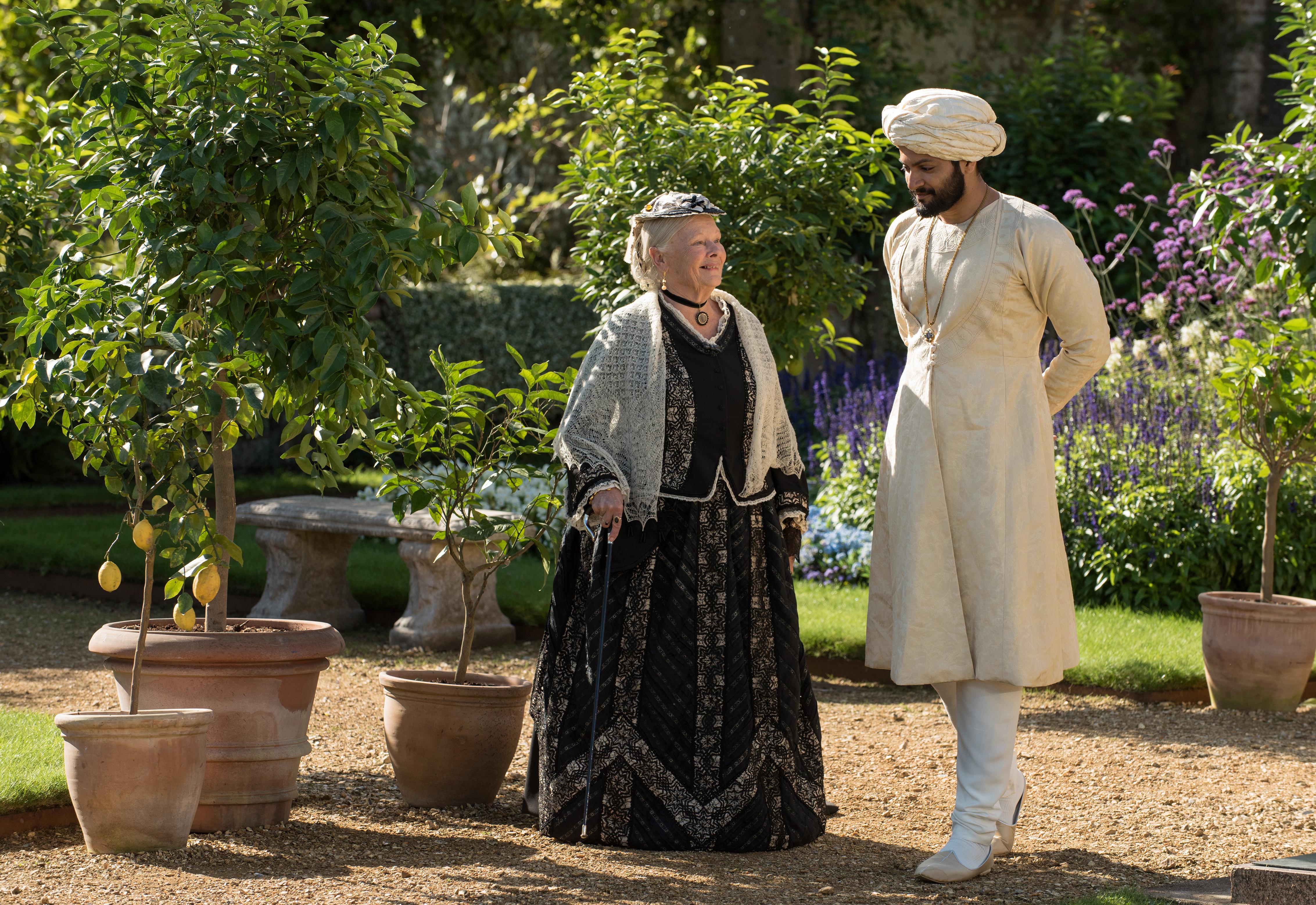 Judi Dench as Queen Victoria and Ali Fazal as Abdul Karim.