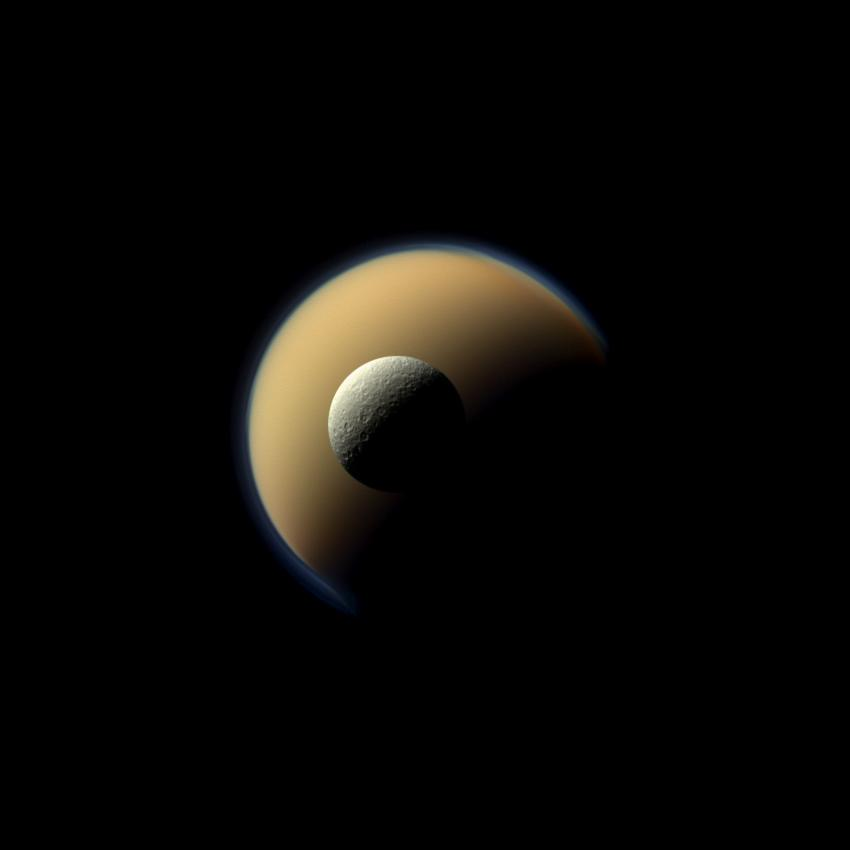 Here Cassini captures Saturn's largest and second largest moons, Titan and Rhea, from over 1 million kilometers away in a true-color image on June 16, 2011.