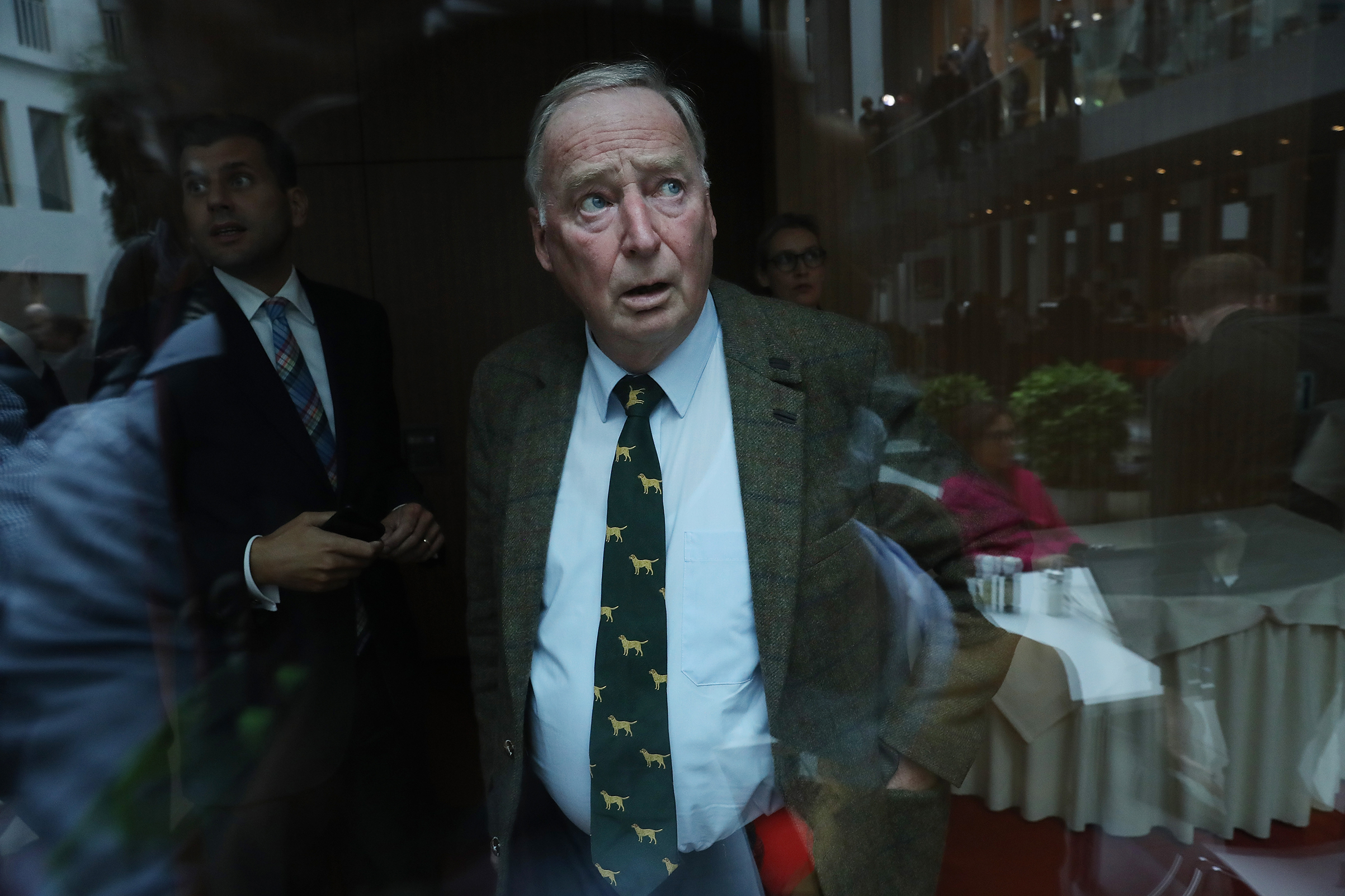 Alexander Gauland, who was a co-lead candidate of the right-wing Alternative for Germany (AfD) party in the German federal elections, is seen through glass following a news conference in Berlin on Sept. 25, 2017. At the conference, AfD member Frauke Petry announced she would quit the party in a surprise move.