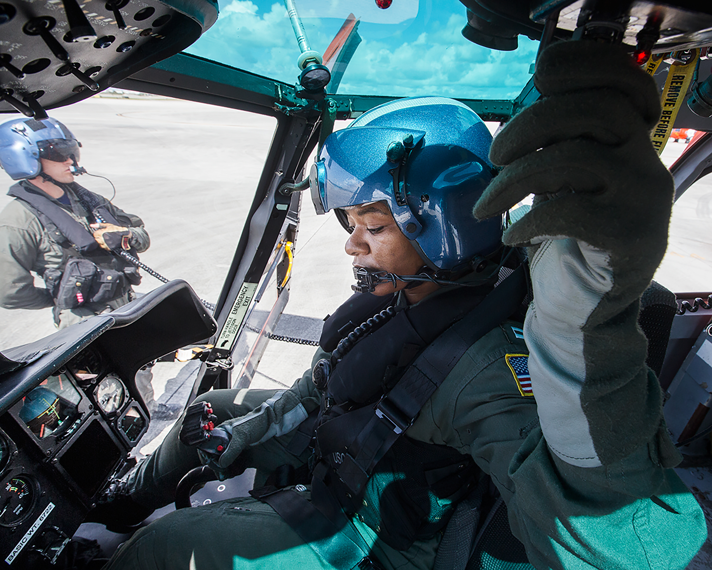 A U.S. Coast Guard lieutenant prepares for damage assessment and search and recovery efforts for Hurricane Irma