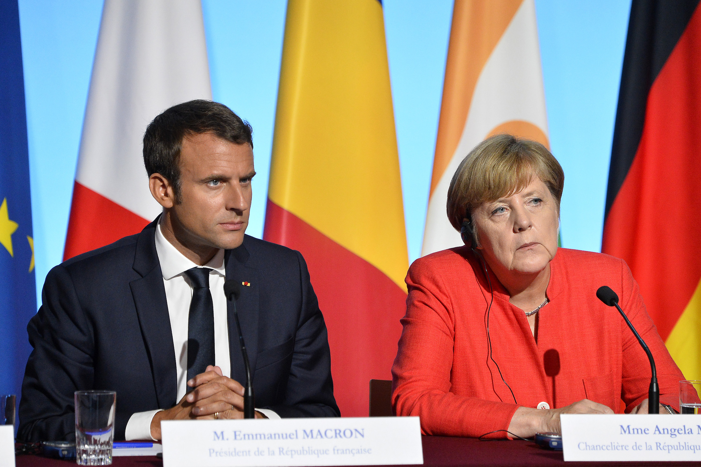 French President Emmanuel Macron and German Chancelor Angela Merkel react during a press conference after the multinational meeting at Elysee Palace on August 28, 2017 in Paris, France.