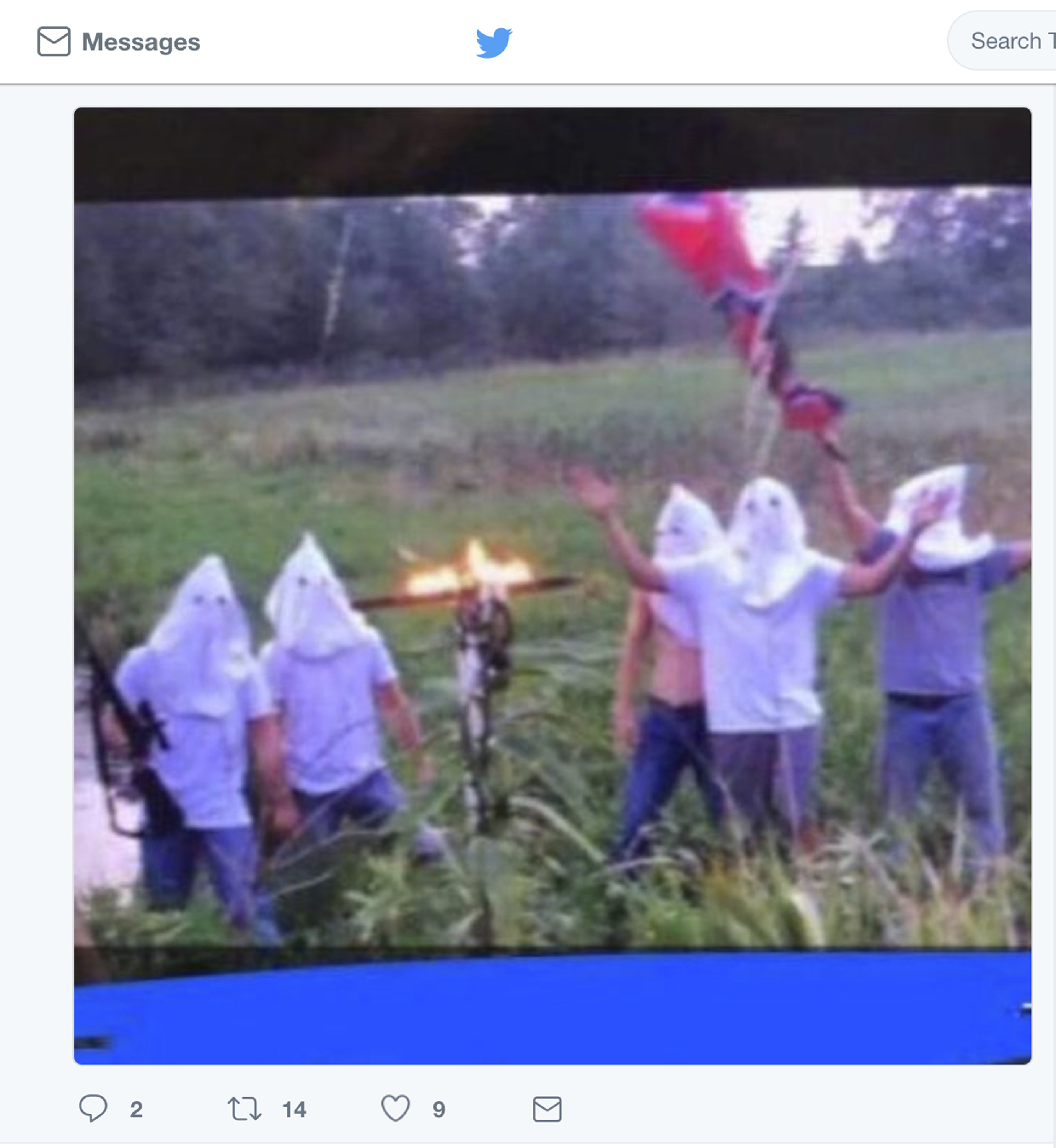 In this screen shot image taken from Twitter, five men wearing white hoods wave a Confederate flag next to a burning cross. The principal of Creston Community High School in southern Iowa says the school has disciplined several students who appeared in the photo, which circulated on social media, after officials became aware of it on Wednesday morning, Sept. 6, 2017.