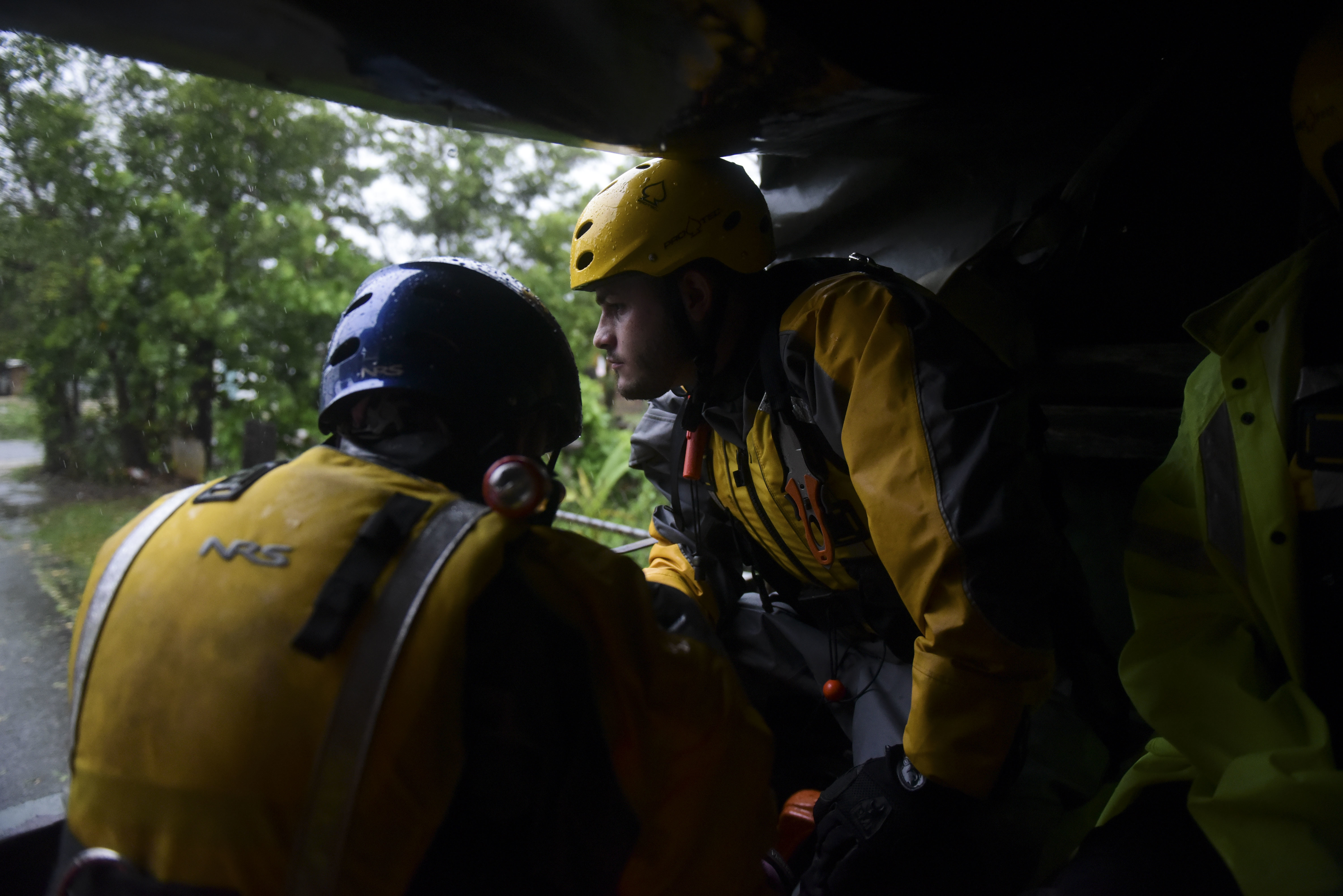 Joshua Alicea, right, rescue staff member from the Municipal Emergency Management Agency toured the streets of the Matelnillo community searching for citizens in the northeastern part of the island in Fajardo, Puerto Rico, Wednesday, Sept. 6, 2017. The US territory was first to declare a state of emergency last Monday, as the National Hurricane Center forecast that the storm would strike the Island Wednesday.