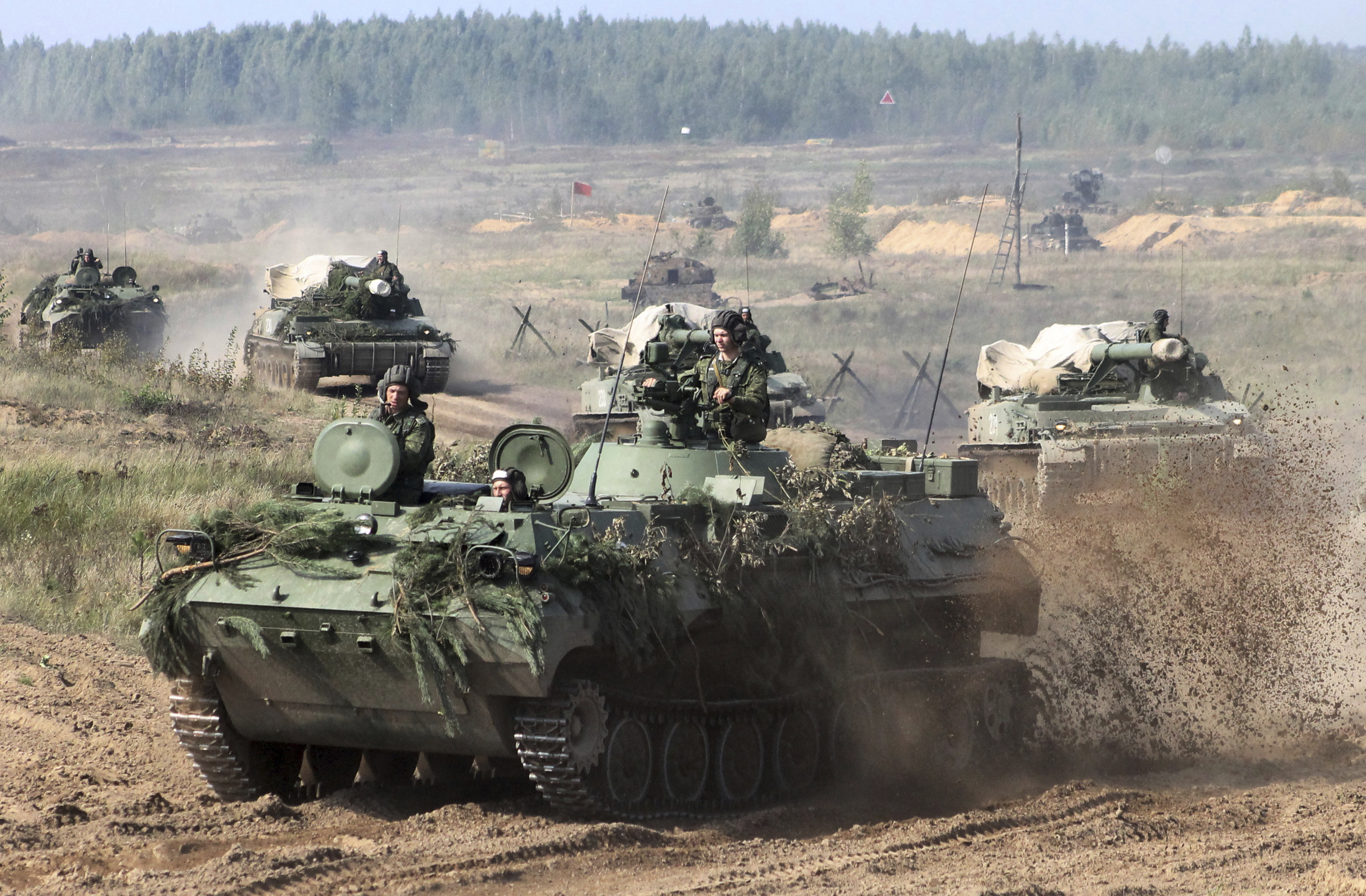 Belarusian army vehicles drive preparing for war games at an undisclosed location in Belarus on Sept. 11, 2017.