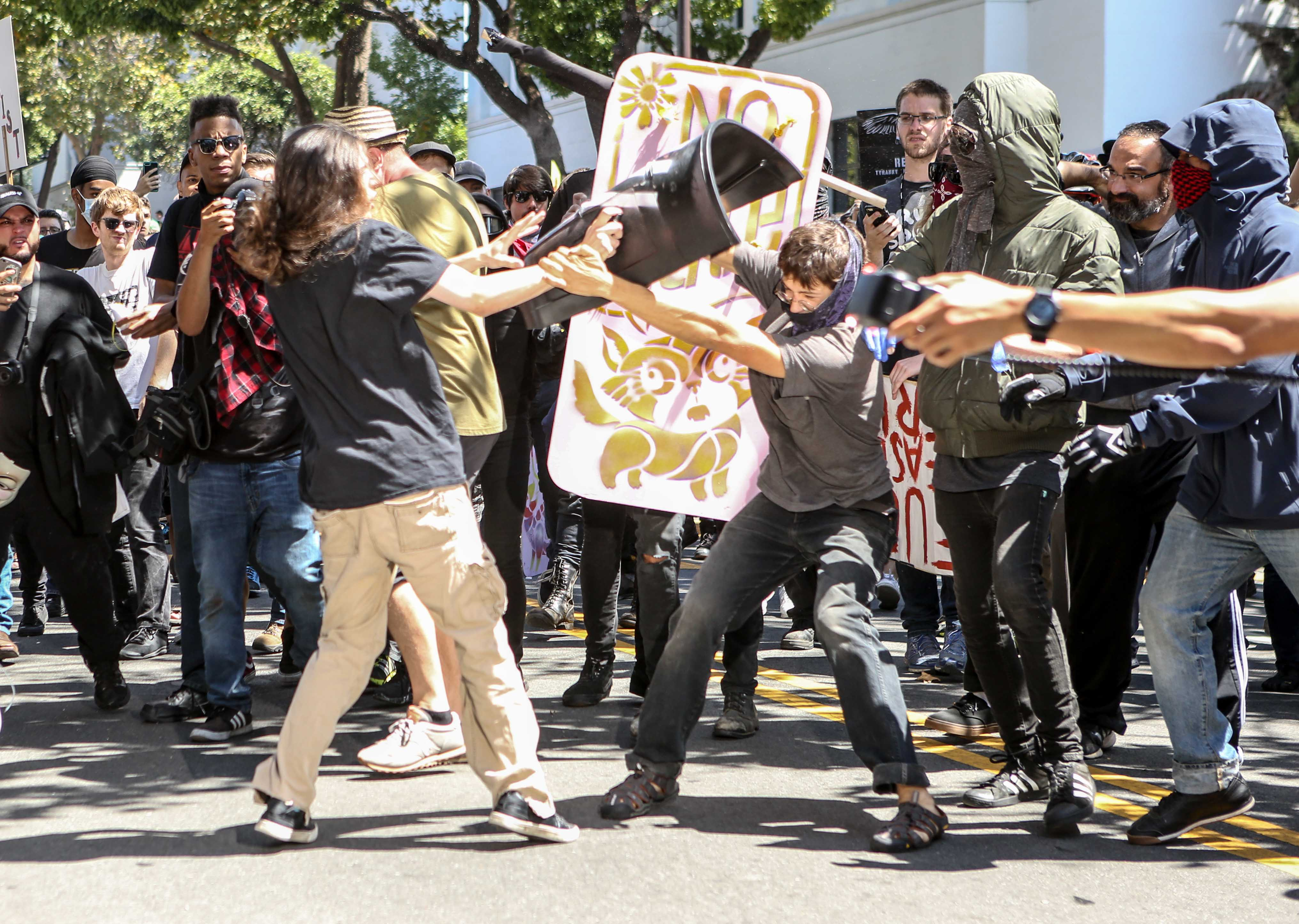No-To-Marxism rally members and counter protesters clash on Aug. 27, 2017 at Martin Luther King Park Jr. Civic Center Park in Berkeley, California.