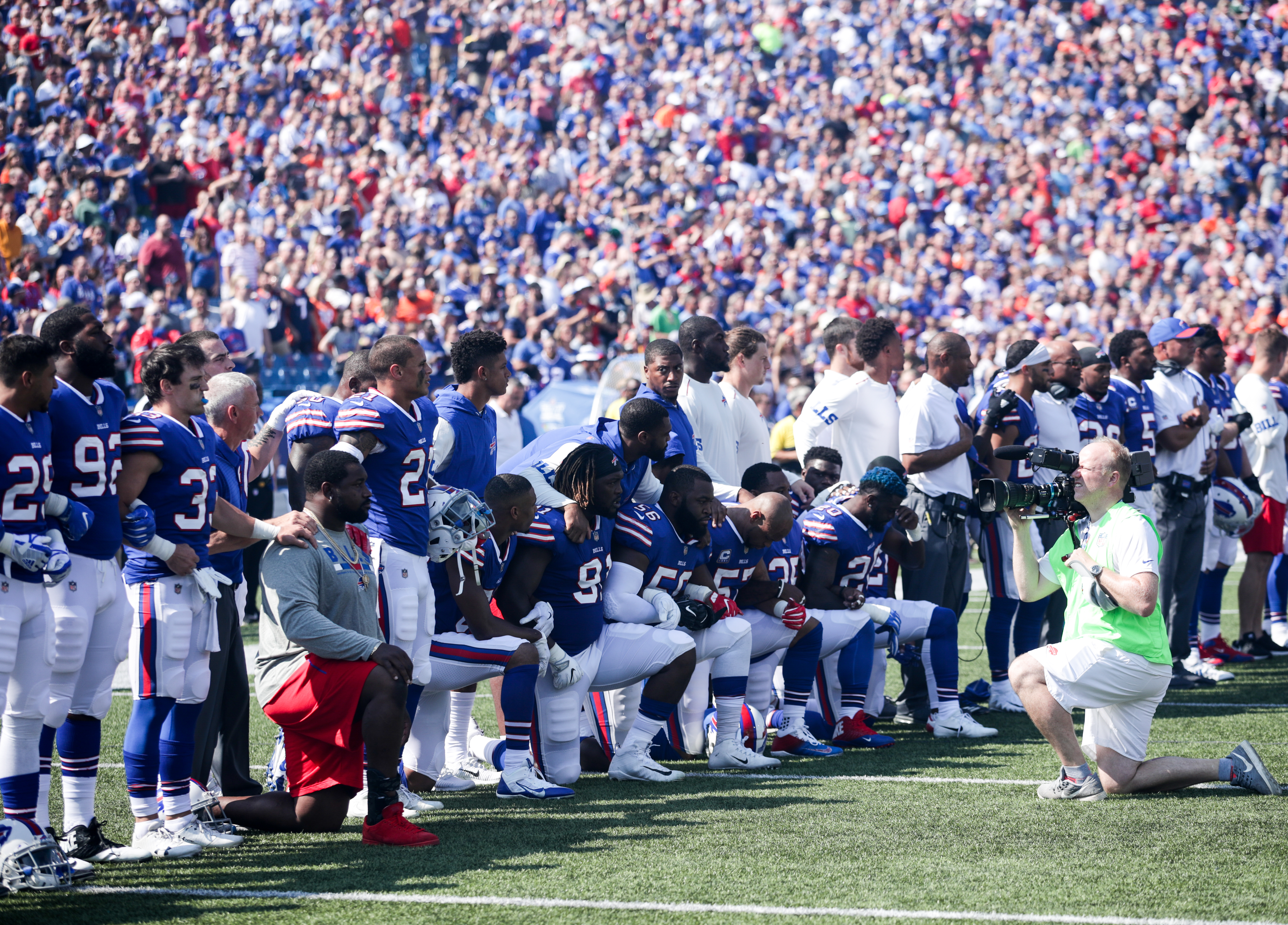 Buffalo Bills players kneel during the national anthem before their game against the Denver Broncos on Sept. 24, 2017 at New Era Field in Orchard Park, New York.