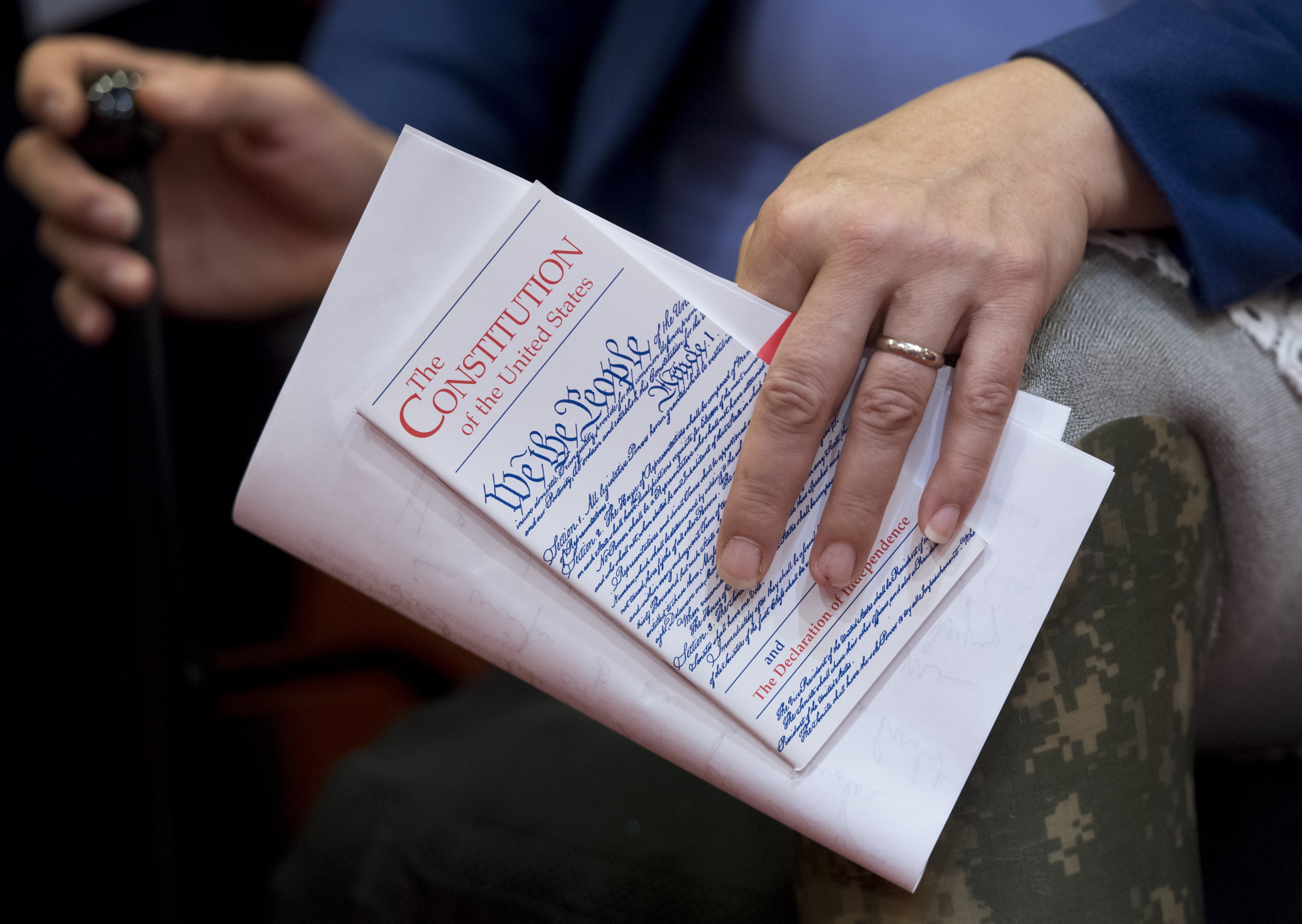 U.S. Senator Tammy Duckworth, Democrat of Illinois, holds a pocket US Constitution at a press conference in Washington, D.C., June 20, 2017.