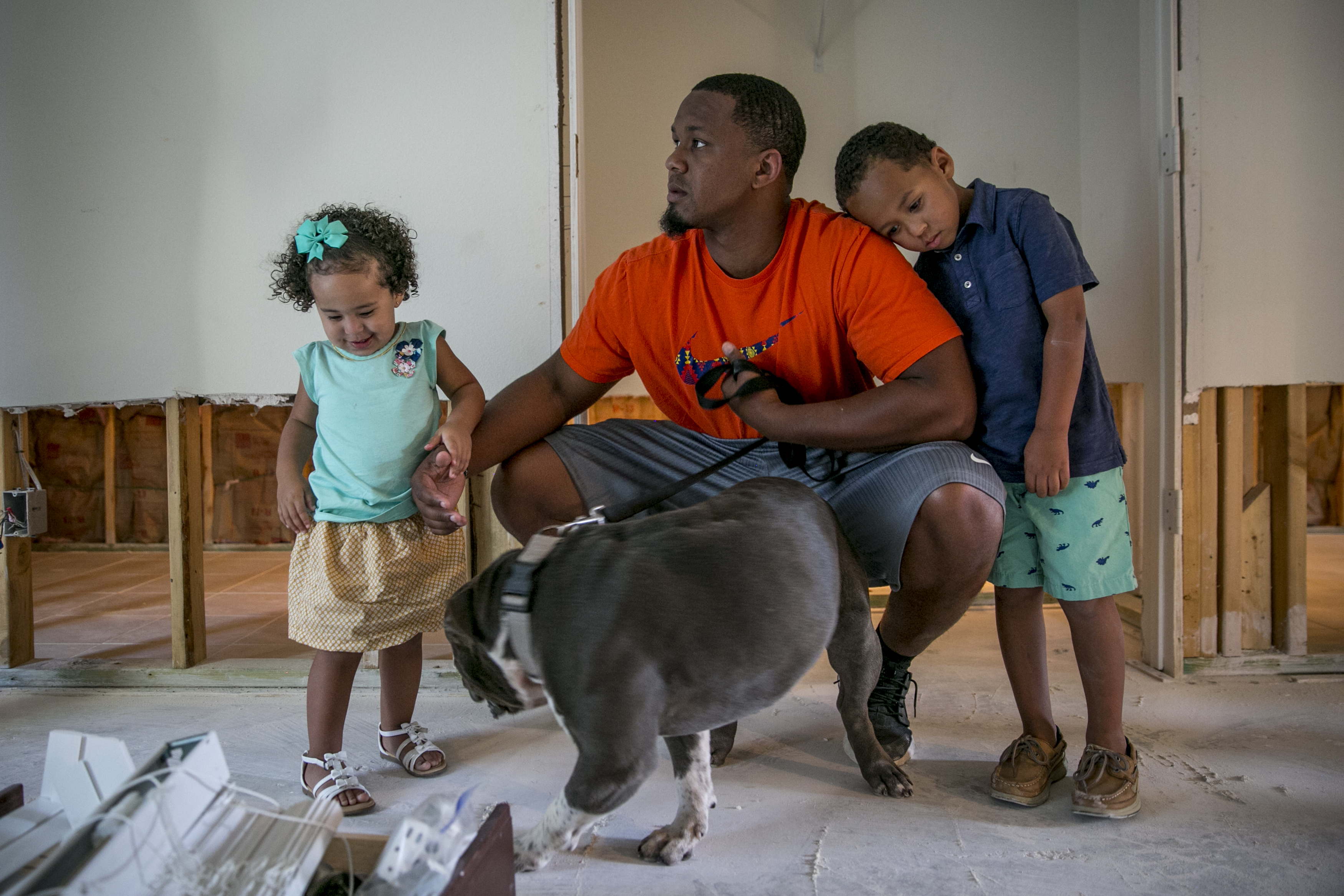 Isiah and his children Bryson and Aubree inside their home.