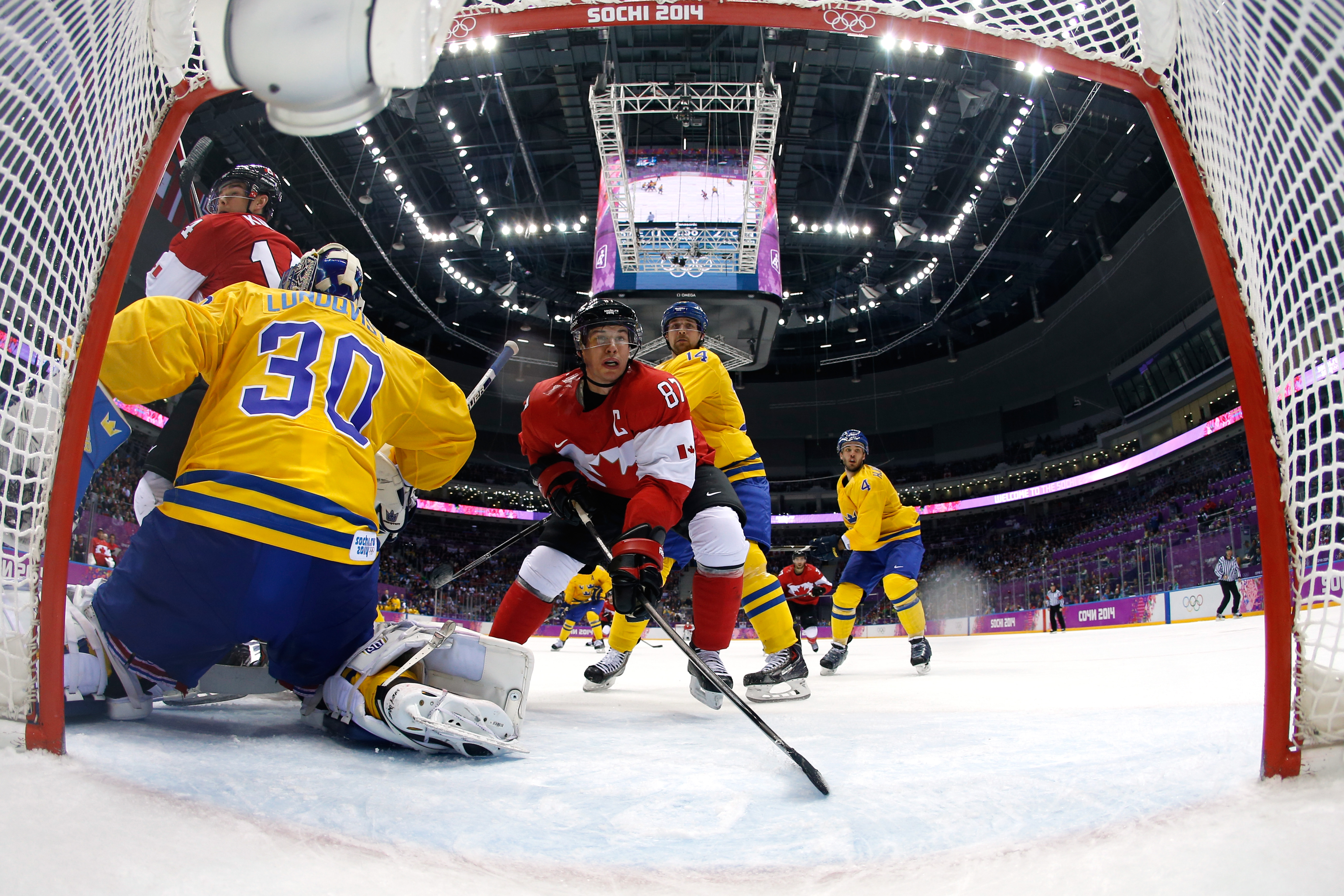 Henrik Lundqvist #30 of Sweden defends his goal as Sidney Crosby #87 of Canada closes in during the Men's Ice Hockey Gold Medal match on Day 16 of the 2014 Sochi Winter Olympics at Bolshoy Ice Dome on February 23, 2014 in Sochi, Russia. (Pool—Getty Images)