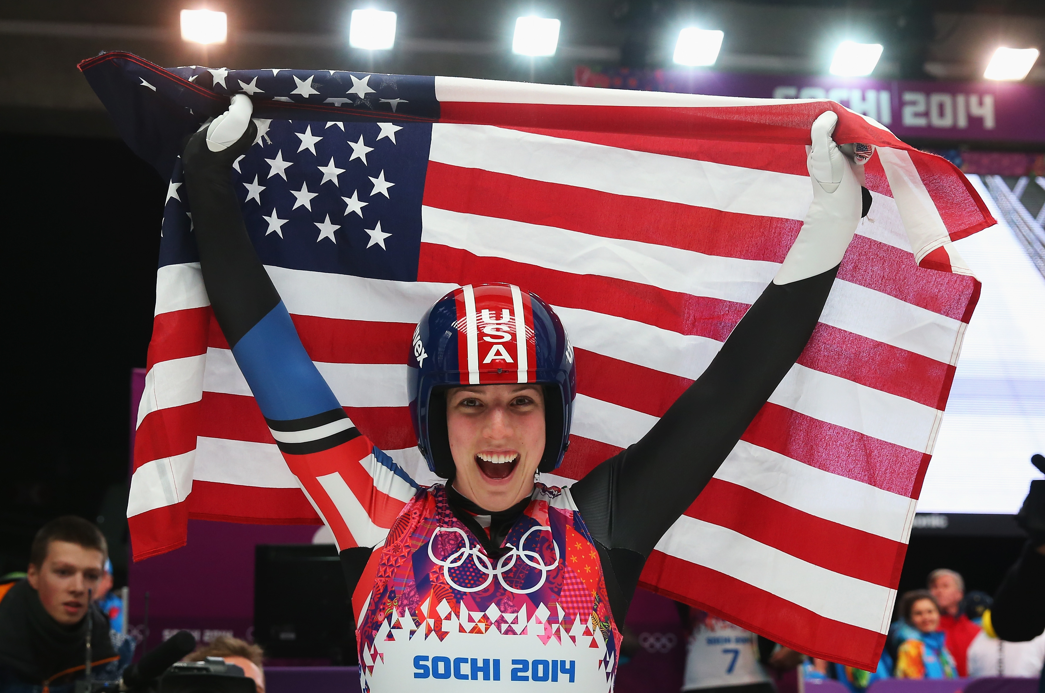 Erin Hamlin of the United States celebrates winning bronze medal in the Women's Luge Singles on Day 4 of the Sochi 2014 Winter Olympics at Sliding Center Sanki on February 11, 2014 in Sochi, Russia. (Alexander Hassenstein—Getty Images)