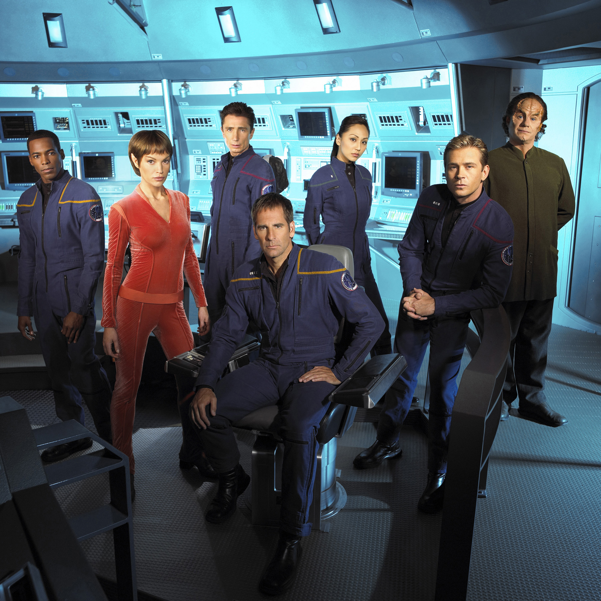Promotional portrait of the cast of the UPN television series, 'Star Trek: Enterprise,' in costume and on set, 2003. L-R: Anthony Montgomery, Jolene Blalock, Dominic Keating, Scott Bakula, Linda Park, Connor Trinneer and John Billingsley. (Photo by James Sorenson/CBS Photo Archive/Getty Images)