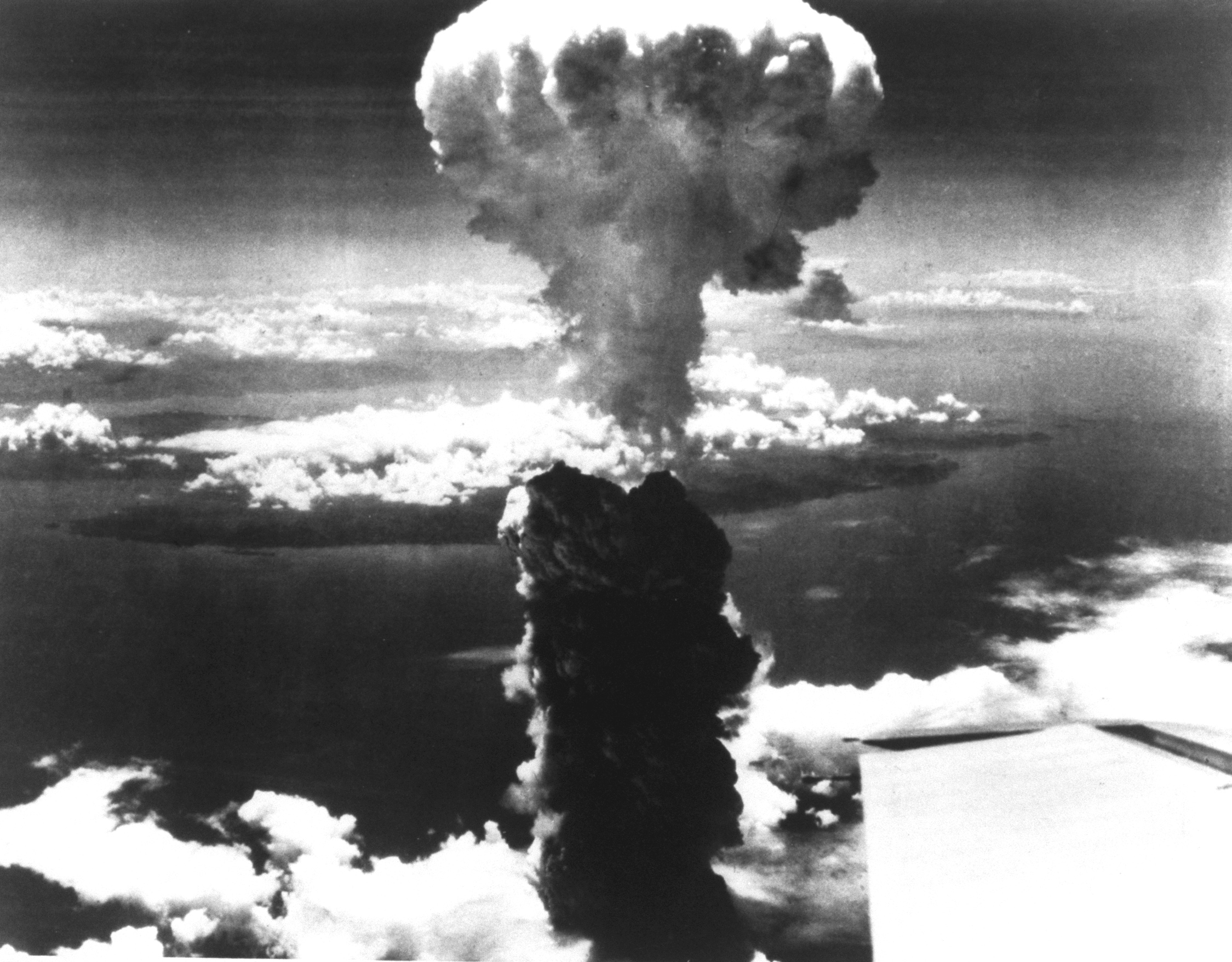 A mushroom cloud forms over Nagasaki, Japan after the dropping of the second atomic bomb.
