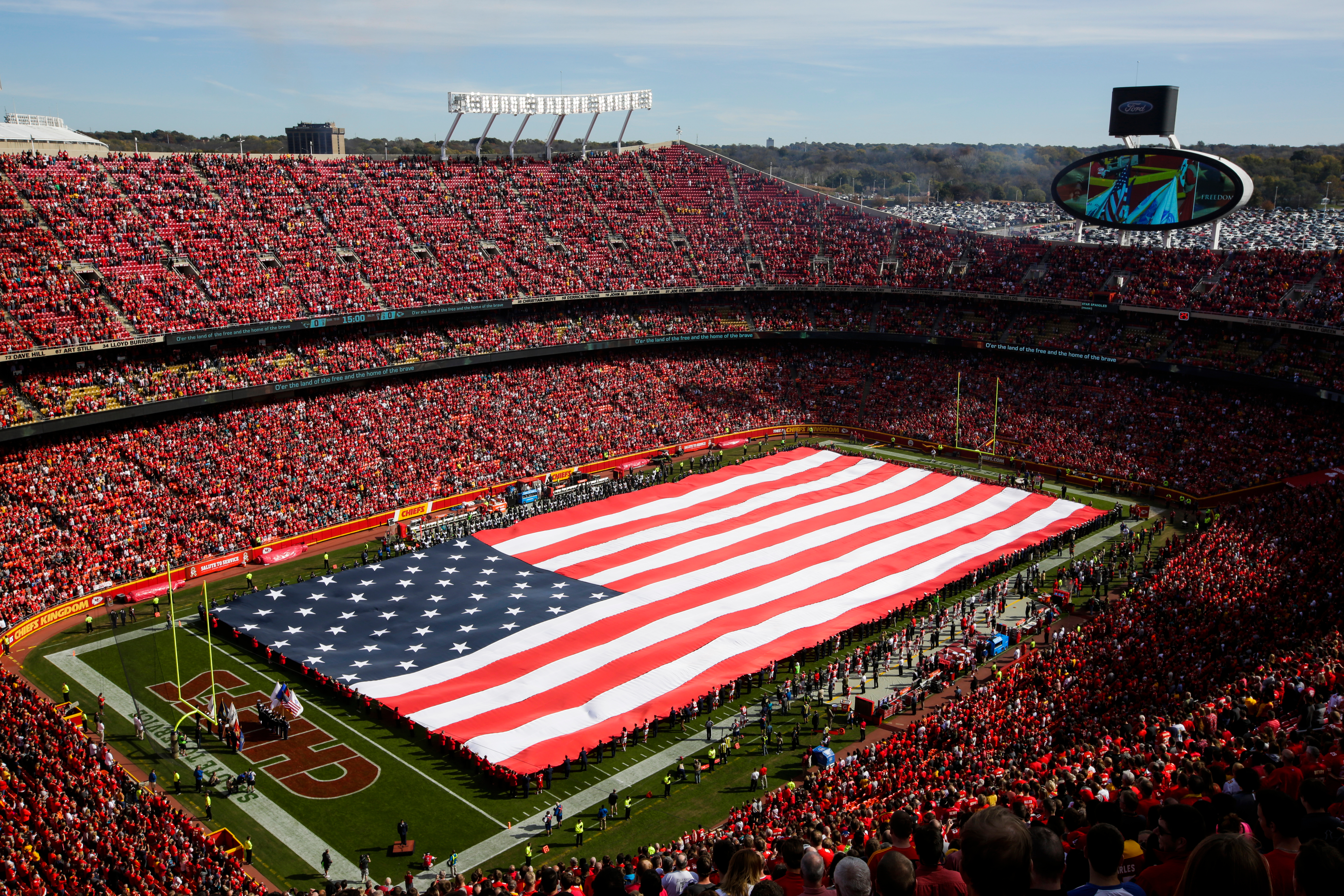 A full field American flag is extended by members of the United States military during the national anthem before the game between the Jacksonville Jaguars and Kansas City Chiefs at Arrowhead Stadium on November 6, 2016 in Kansas City, Missouri. (Jamie Squire—Getty)