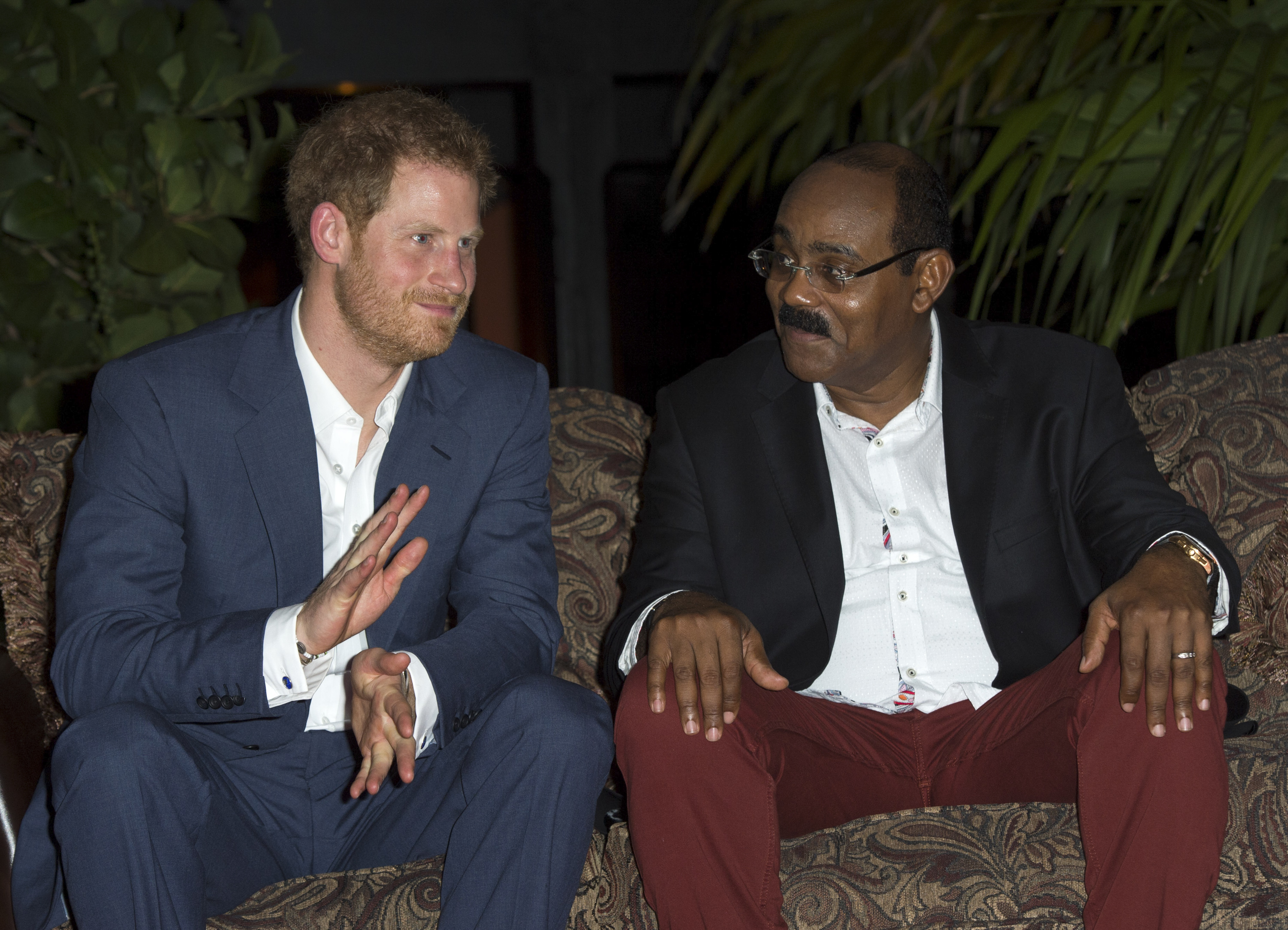 Prime Minister of Antigua and Barbuda Gaston Browne alongside Prince Harry during the British royal's official visit to Antigua on Nov. 21, 2016