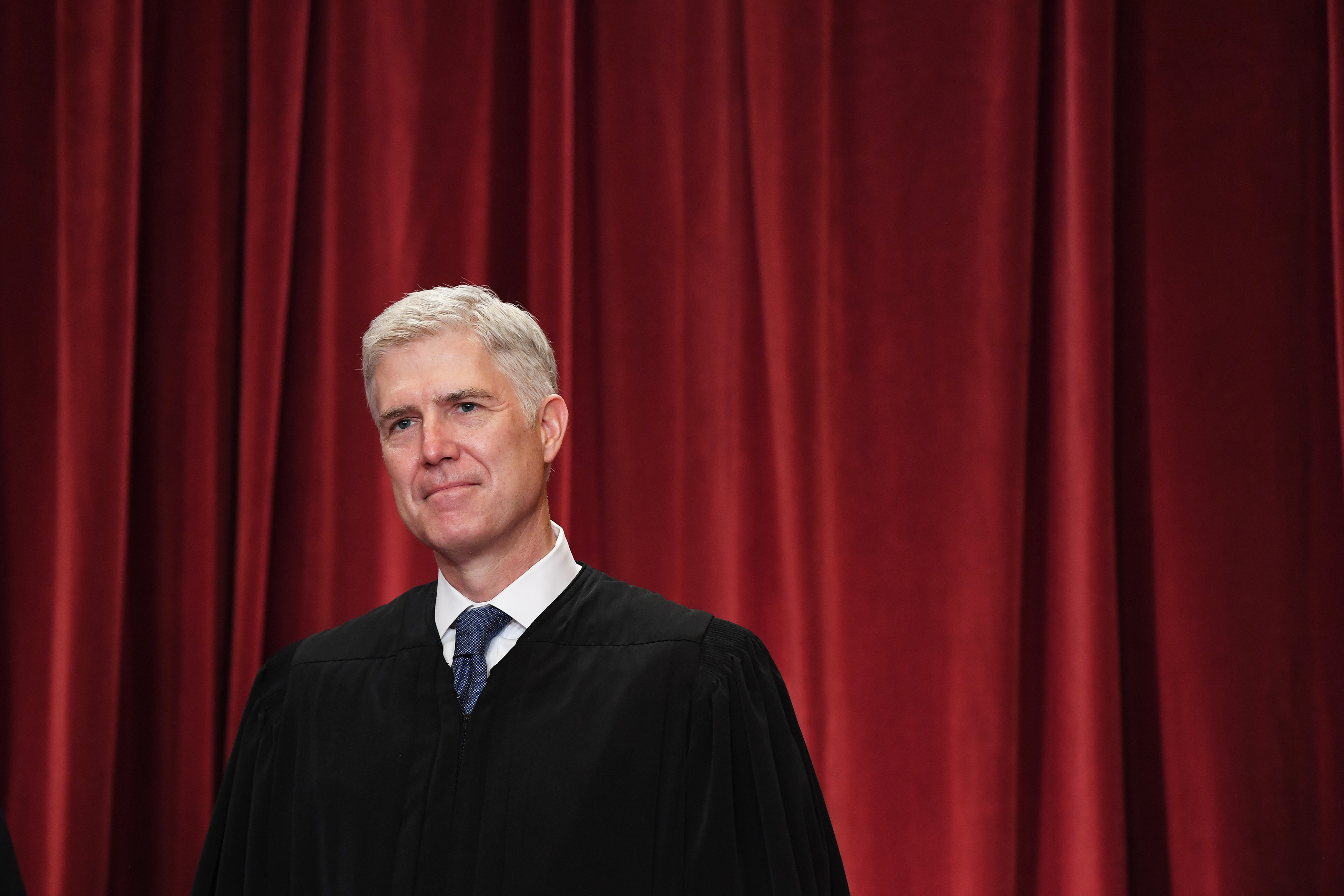 Associate Justice Neil Gorsuch poses with other justices for a portrait in the east conference room of the building of the Supreme Court of the United States on June 1, 2017.